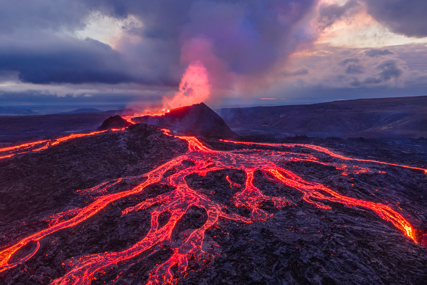 Fagradalsfjall volcano on the Reykjanes Peninsula in Iceland erupting with rivers of molten rock.