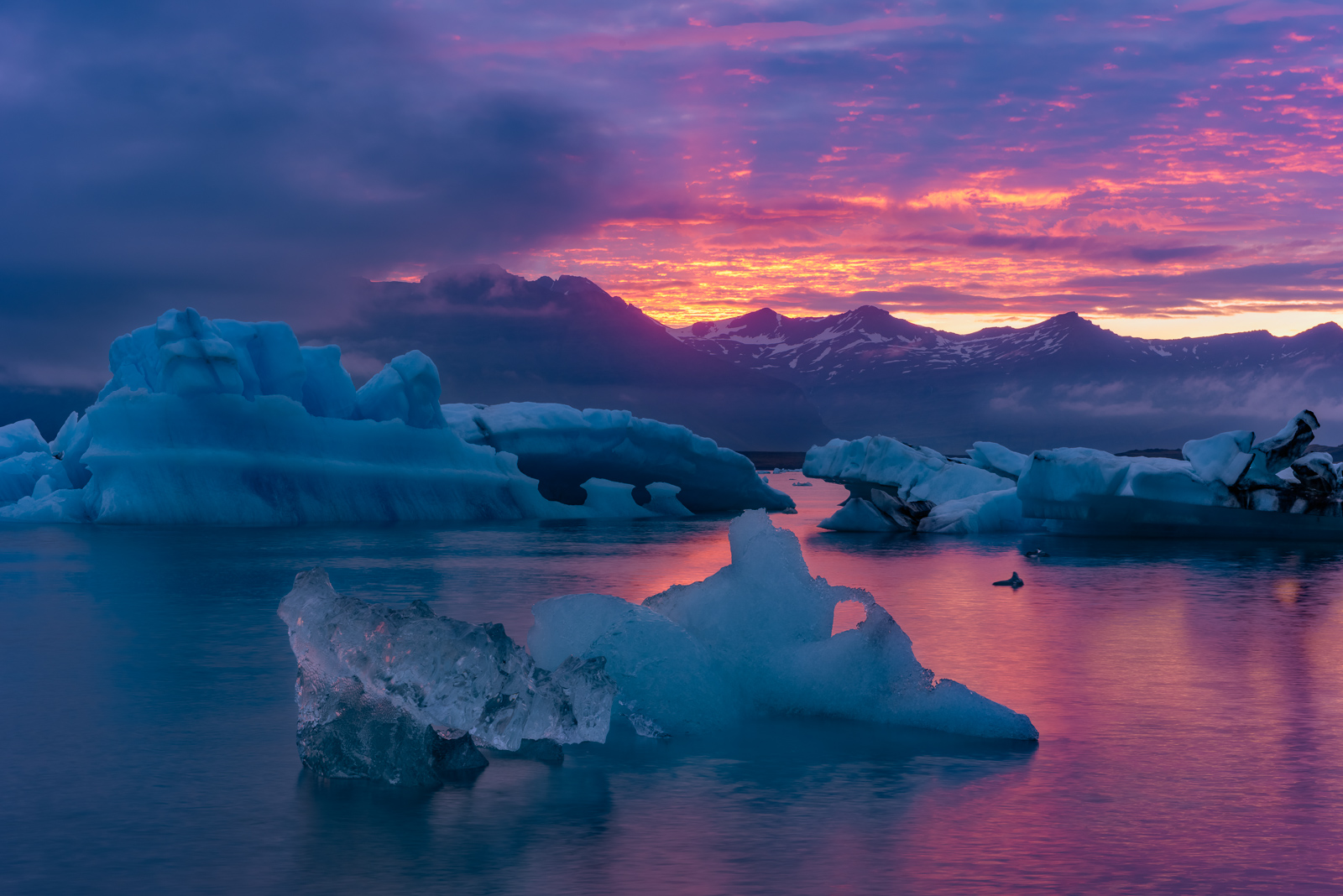 Huge iceburgs at sunset in Jökulsárlón, Iceland.Add beauty to your space with a Joseph Rossbach limited edition photography...