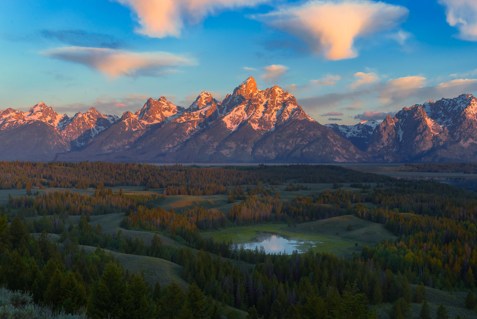 The Teton Range at sunrise with amazing clouds and light.