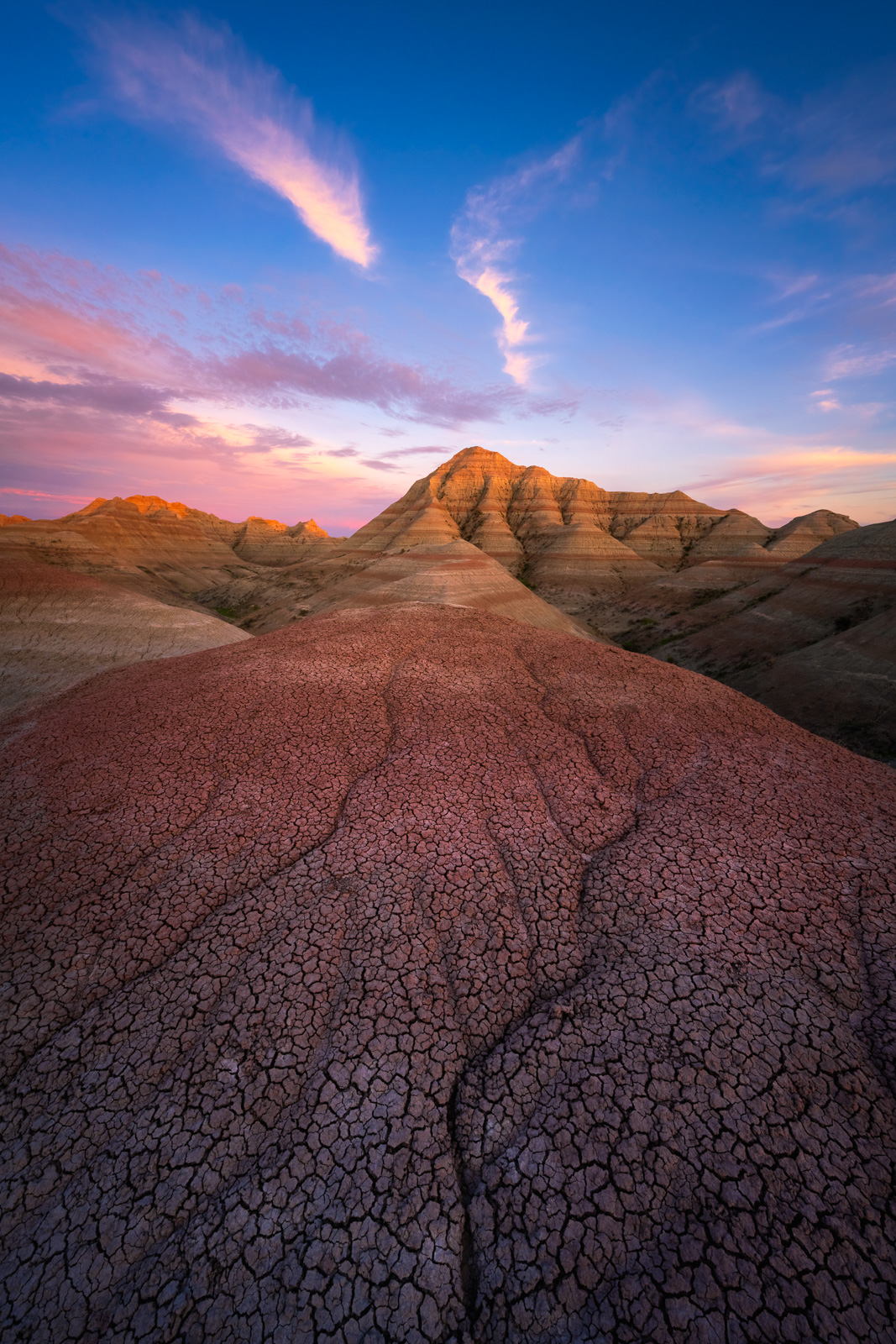 A remote landscape located in the backcountry of Badlands National Park at sunset.
