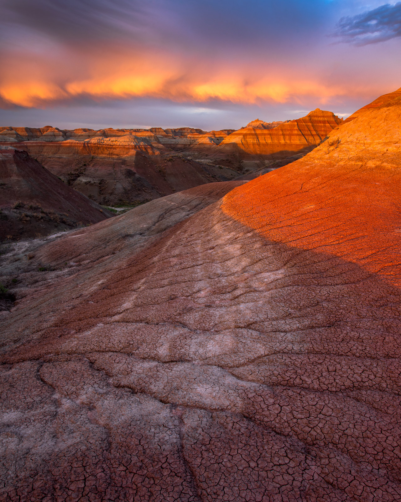 A spectacular display of storm light at sunset in a remote backcountry location deep in the heart of Badlands National Park.