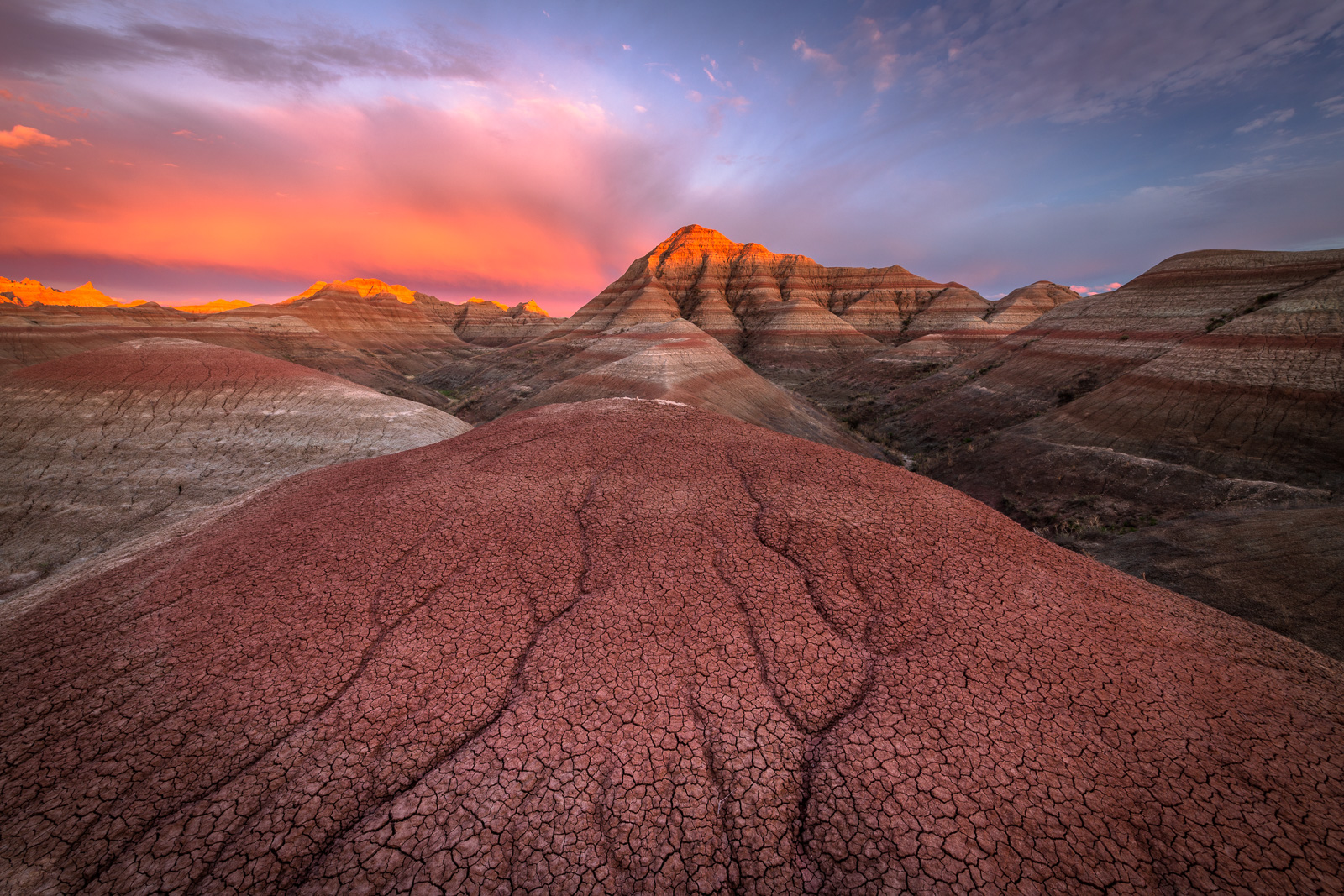 A spectacular sunset over the pyramids and pinnacles of Badlands National Park.