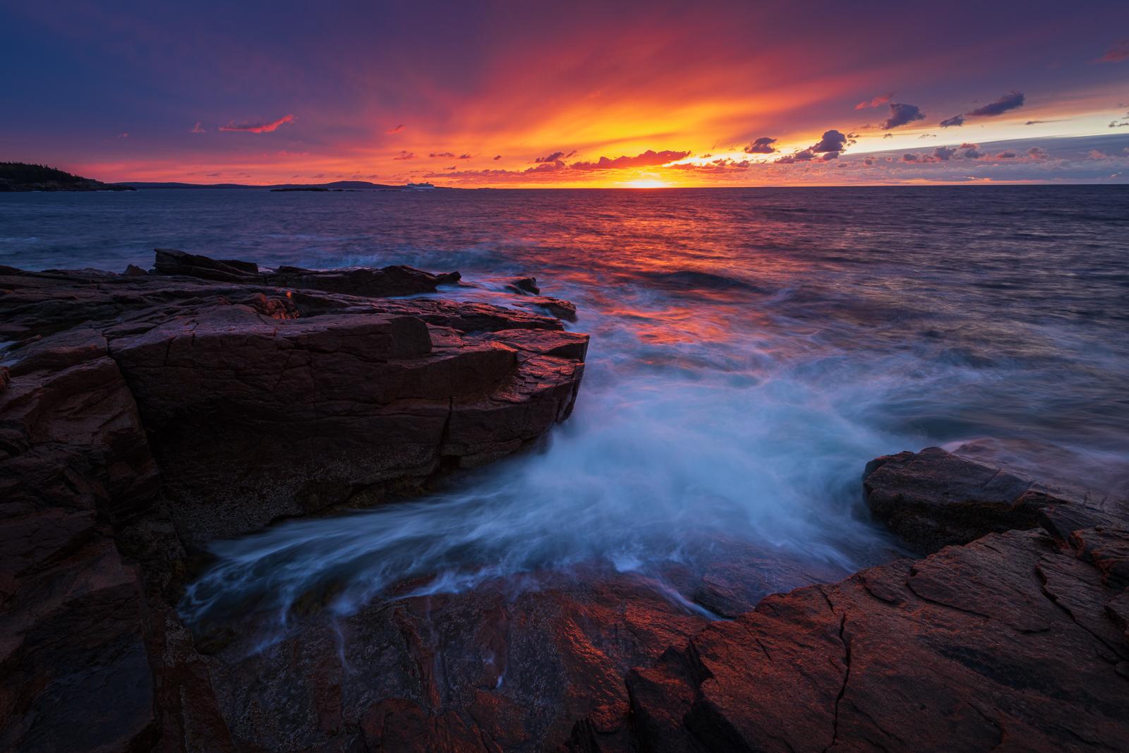 A stunning autumn sunrise from Acadia National Park's rugged coast.