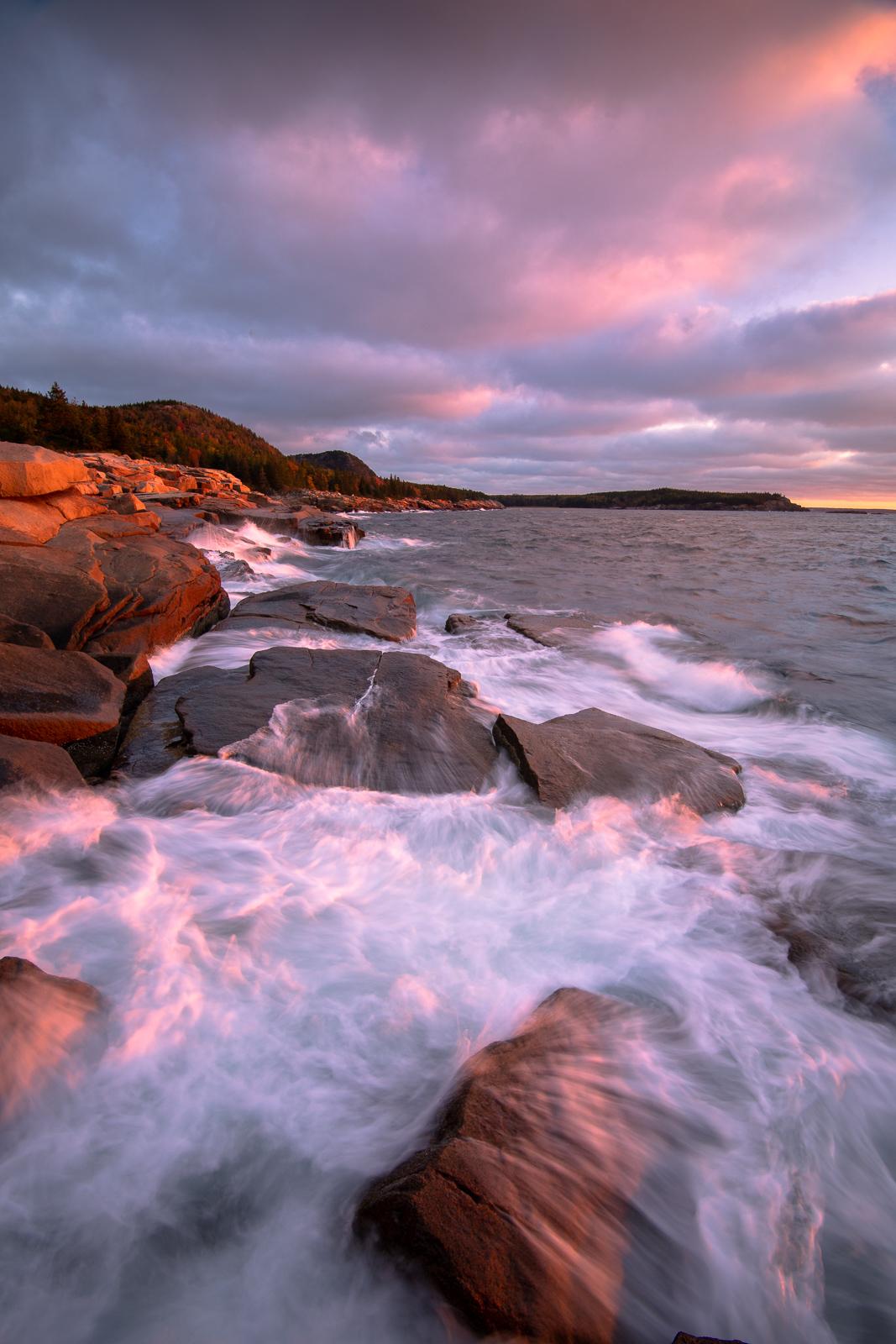 Crashing waves at sunrise along Acadia National Park's rugged grantite coast.