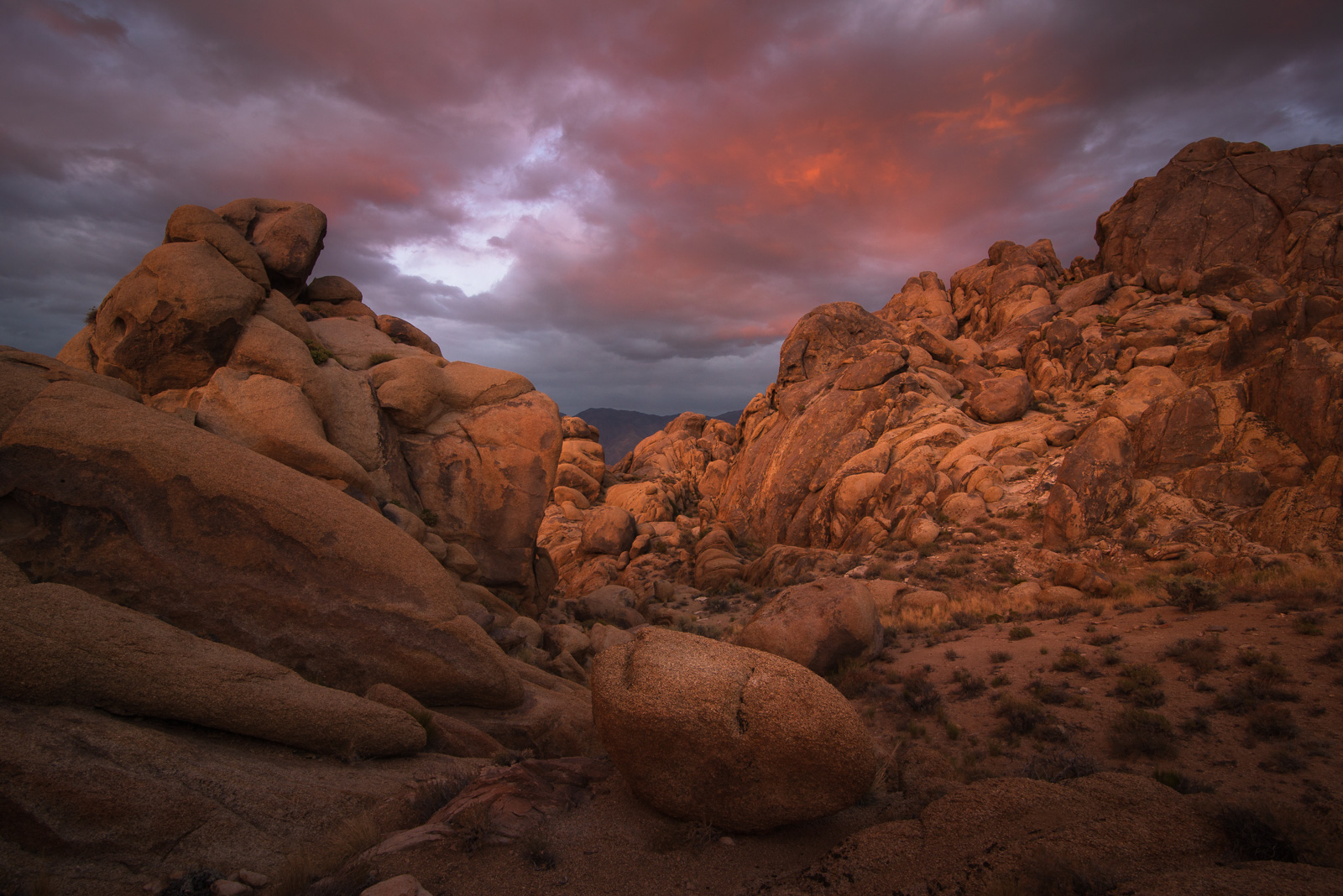A stormy and dramtic sunset from inside a garden of granite, Alabama Hills.
