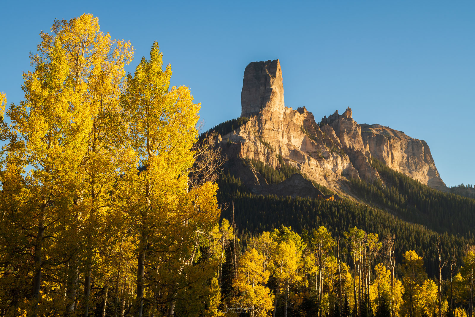 Courthouse Mountain and autumn aspens from Owl Creek Pass.