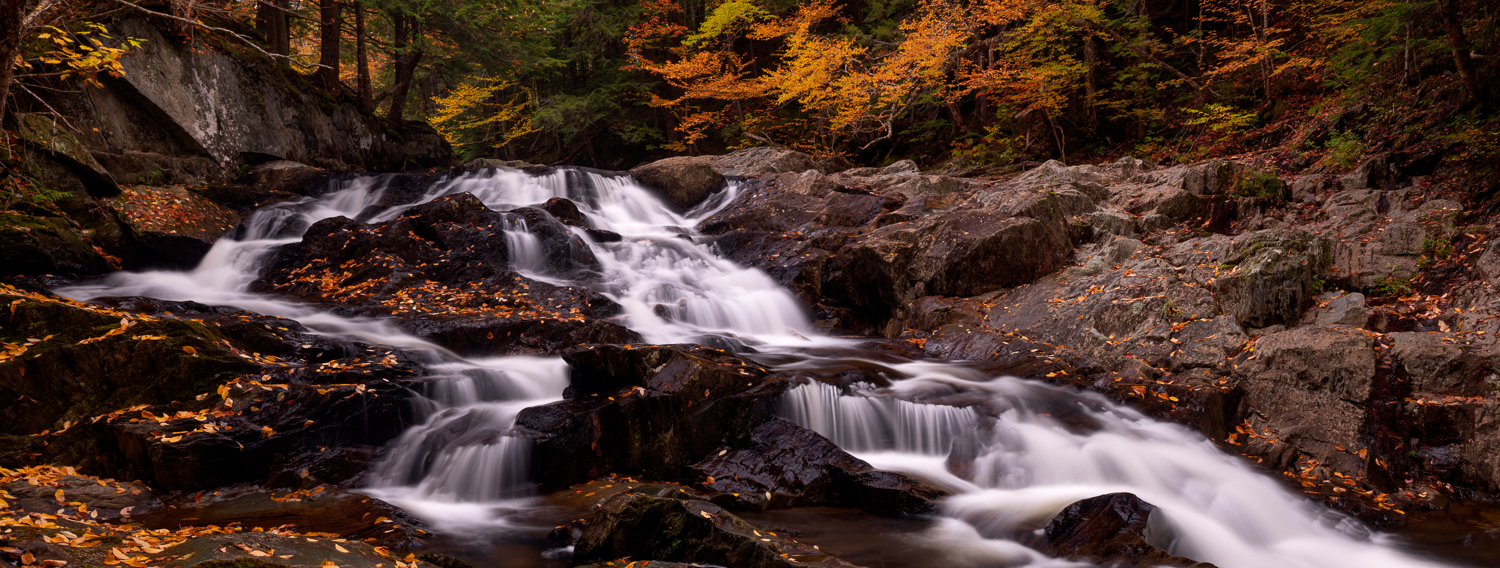 I found this waterfall while bushwhacking off trail in a gorge in Northern Vermont. The fall colors where at peak and I had soft...