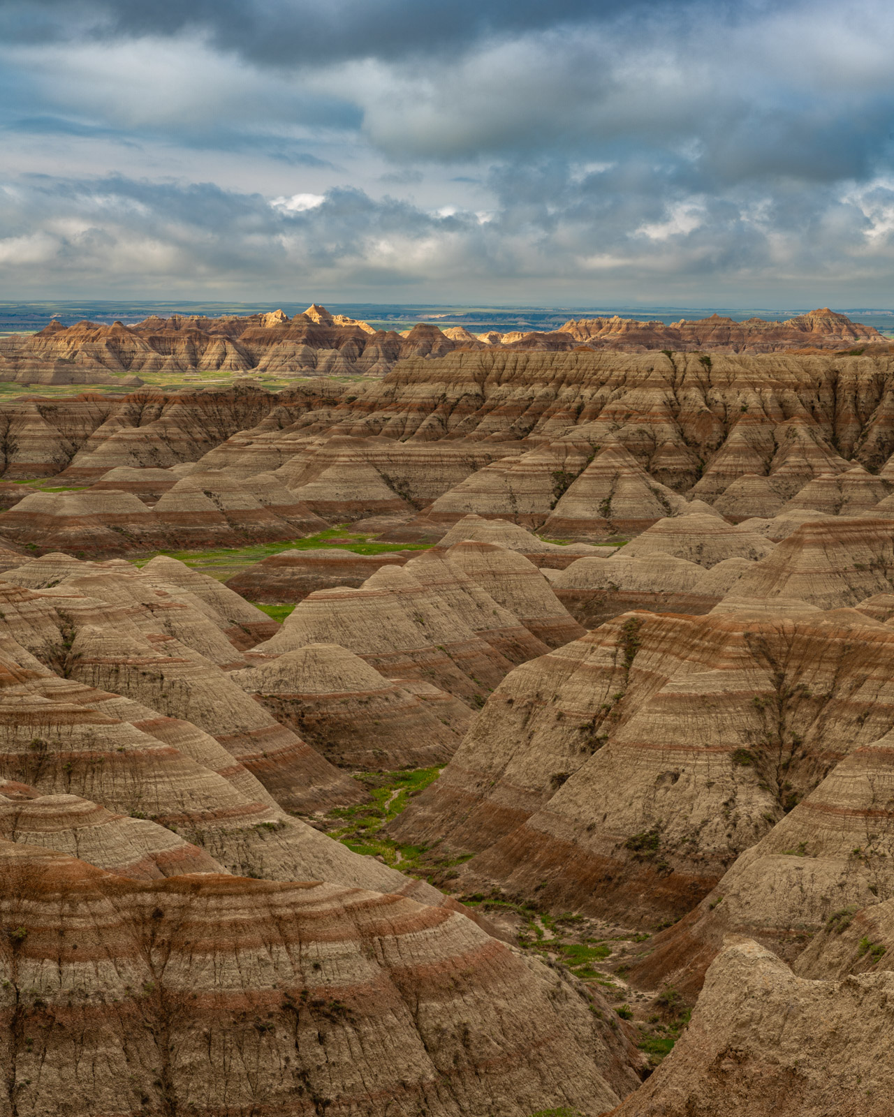 Clearing storm after sunrise across the Badlands of South Dakota.