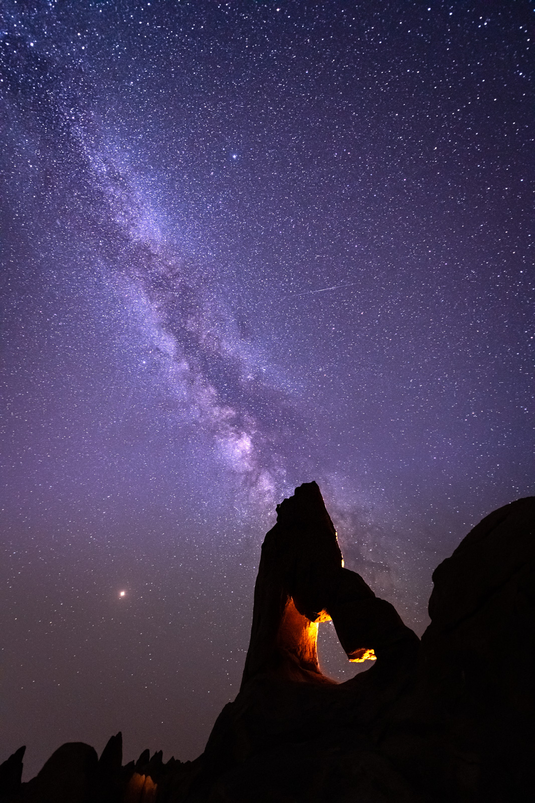 The Milky Way hangs over Boot Arch in the Alabama Hills.