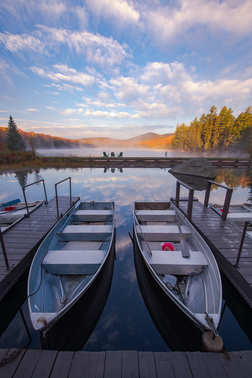 Canoes at sunrise over Noyes Pond, Groton State Forest, Vermont.