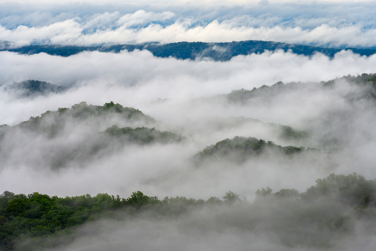 Low clouyds and fog dancing through the mountains of Shenandoah National Park, Virginia.