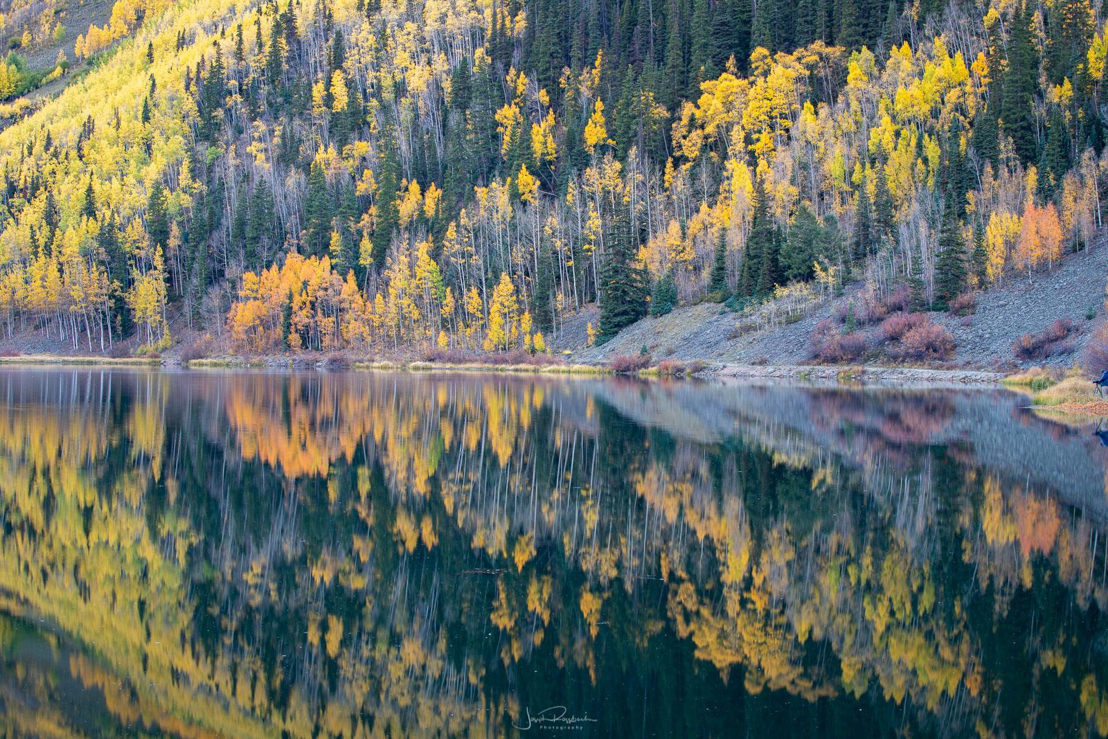 Mirror reflections on Crystal Lake at dawn.