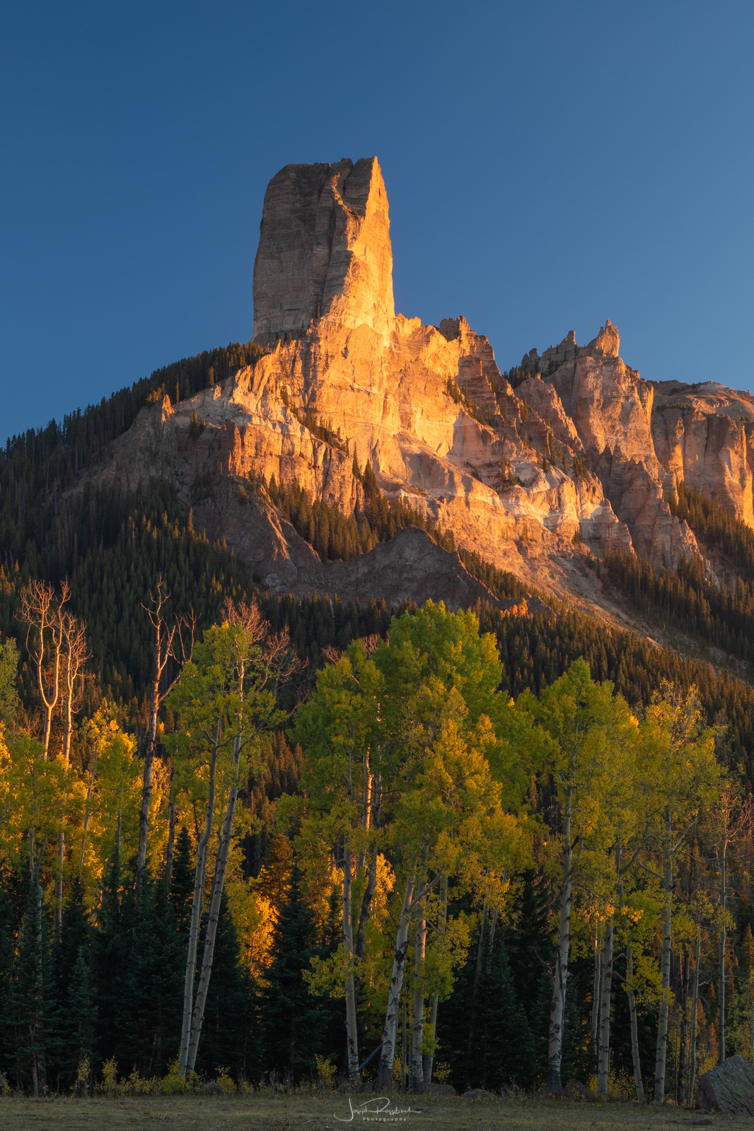 Last light strikes courthouse Mountain at sunset.