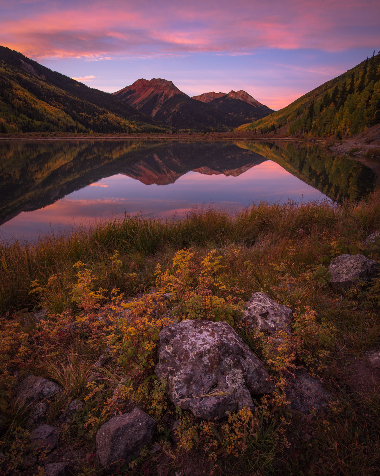 Red Mountain reflects in Crystal Lake at sunrise, San Juan Mountains, Colorado. Add beauty to your space with a Joseph Rossbach...