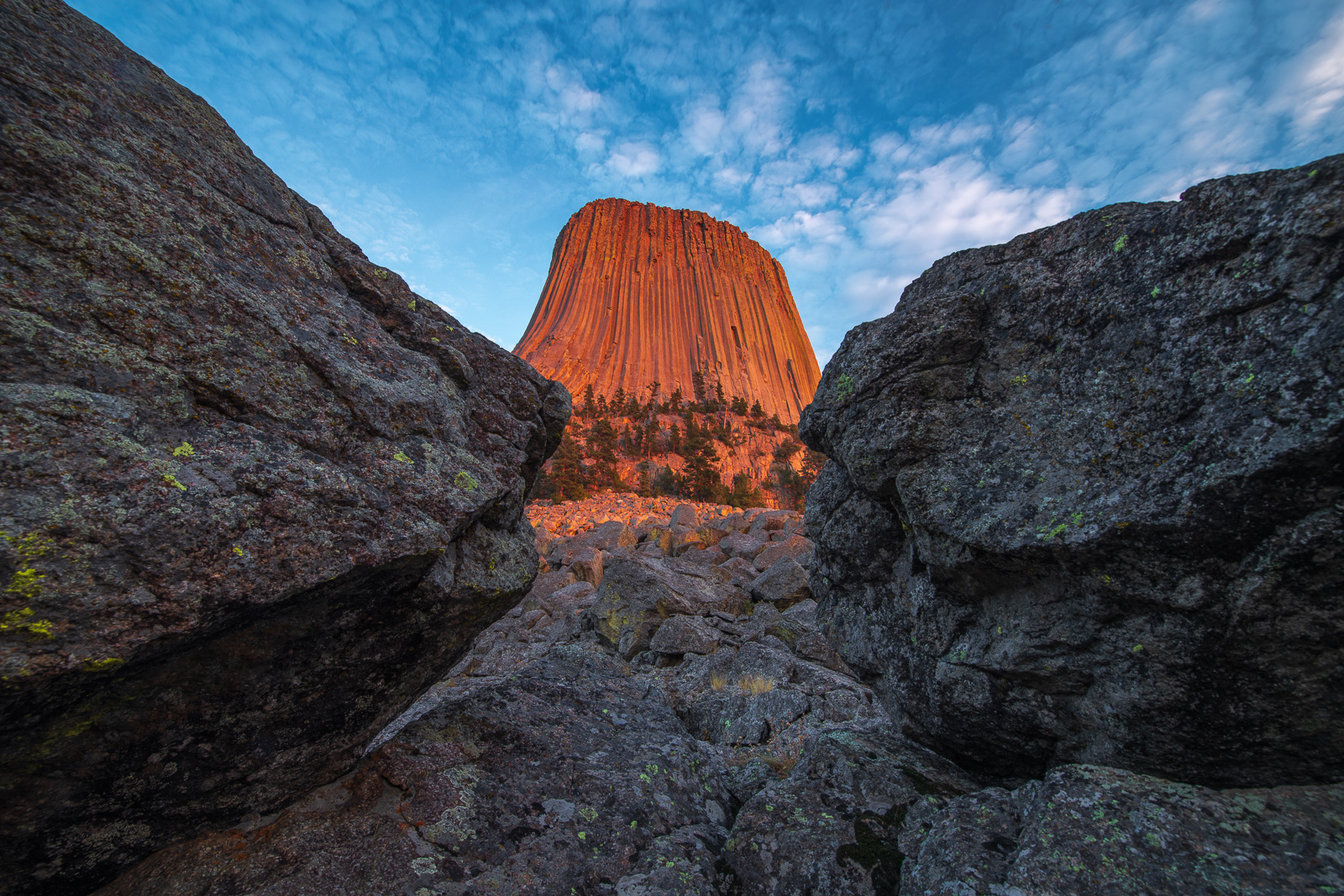 The Tower is a solitary, stump-shaped granite formation that looms 1,267 feet above the tree-lined Belle Fourche River Valley...