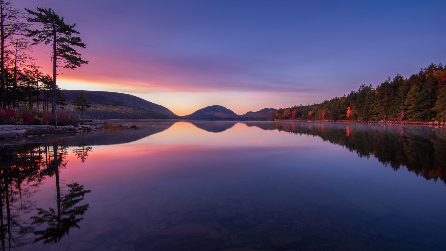 Mirror reflection on Eagle Lake in the autumn, Acadia National Park, Maine