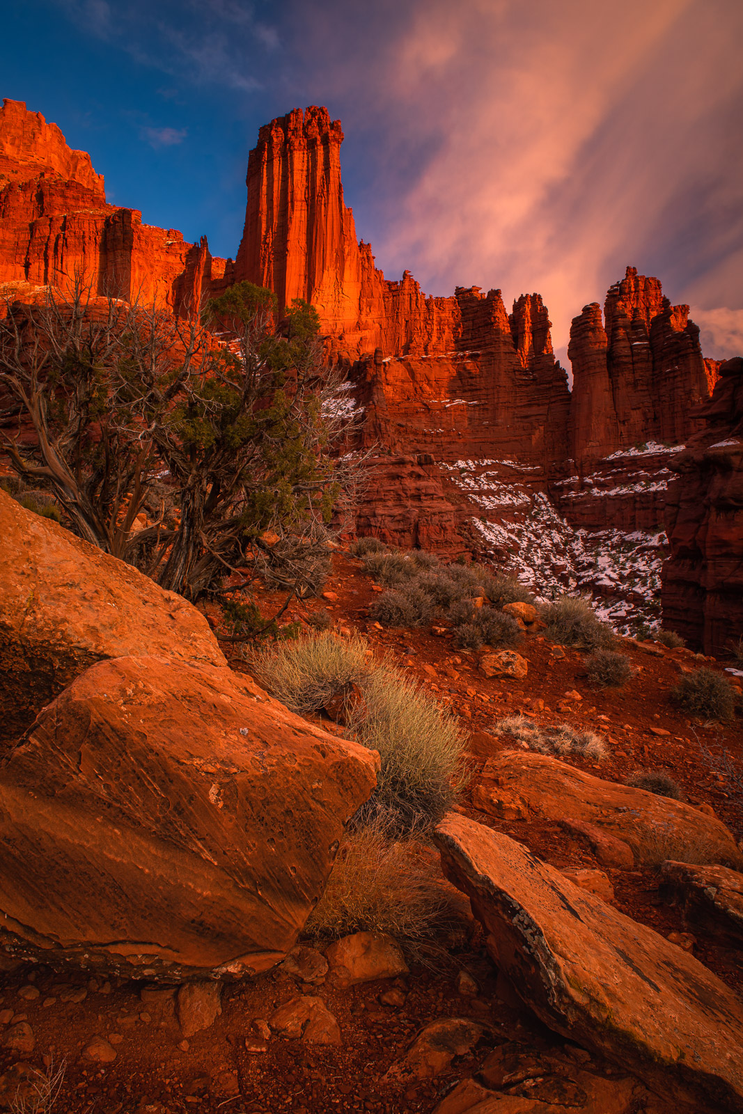 Warm sunset light paints the Fisher Towers as they rise high above Castle Valley just a few miles from the mightry Colorado River...