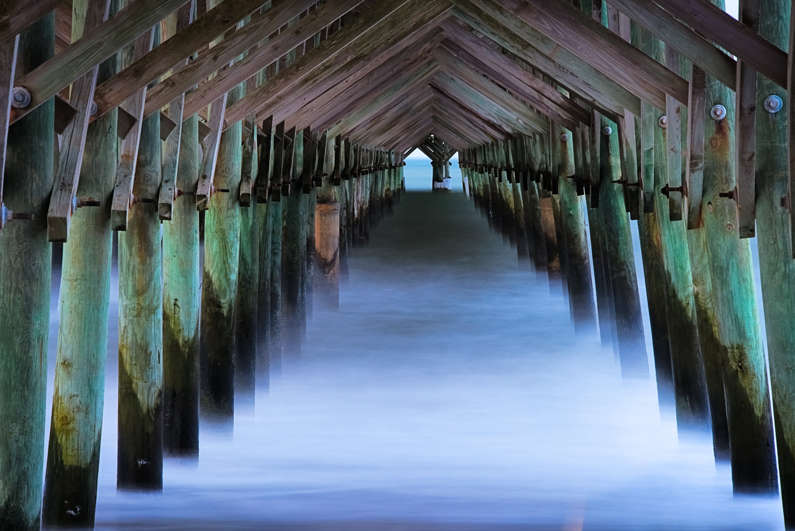 Long exposure of breaking waves below the Folly Beach fishing pier outside of Charleston. Available Print Sizes: 12x18, 16x24...