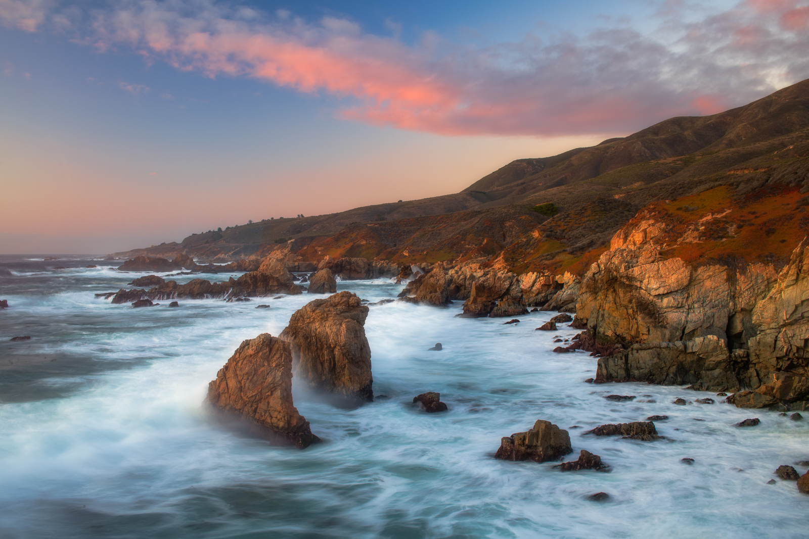Breaking waves along the rugged coast of California's Big Sur.