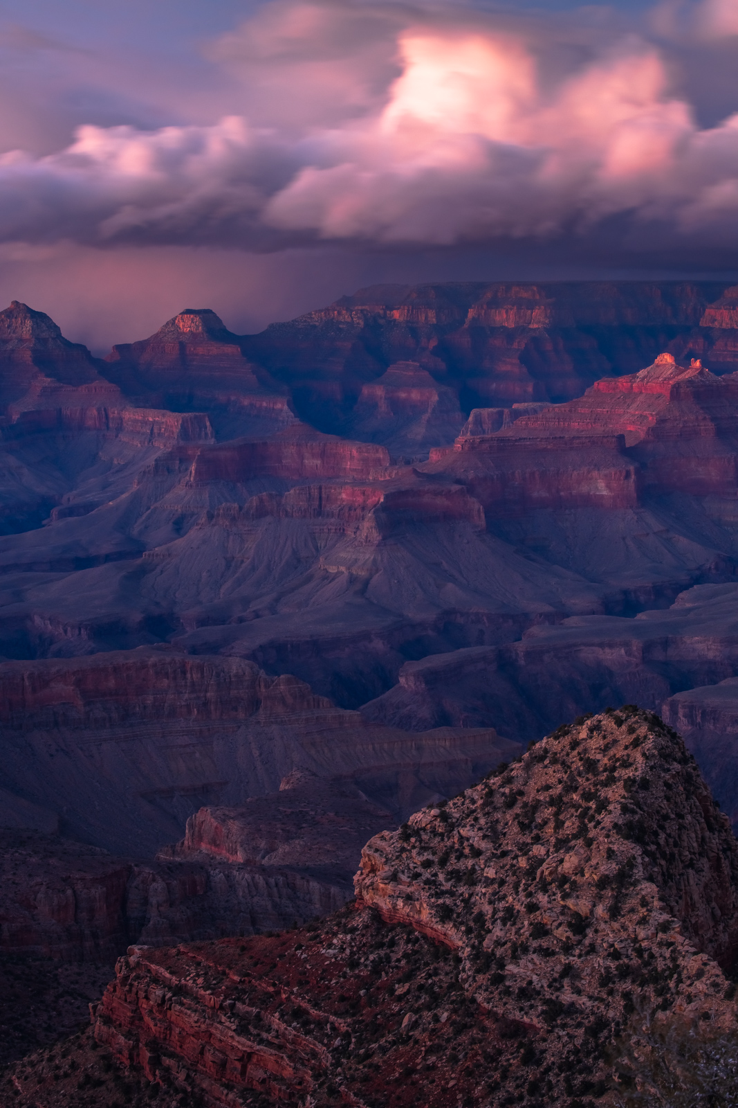 A winter storm at sunset over the Grand Canyon from the South Rim.