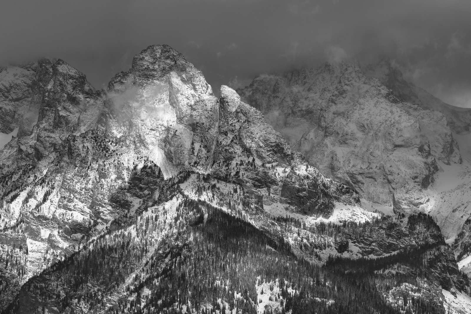 A winter storm hitting the Grand Tetons captured at sunrise.