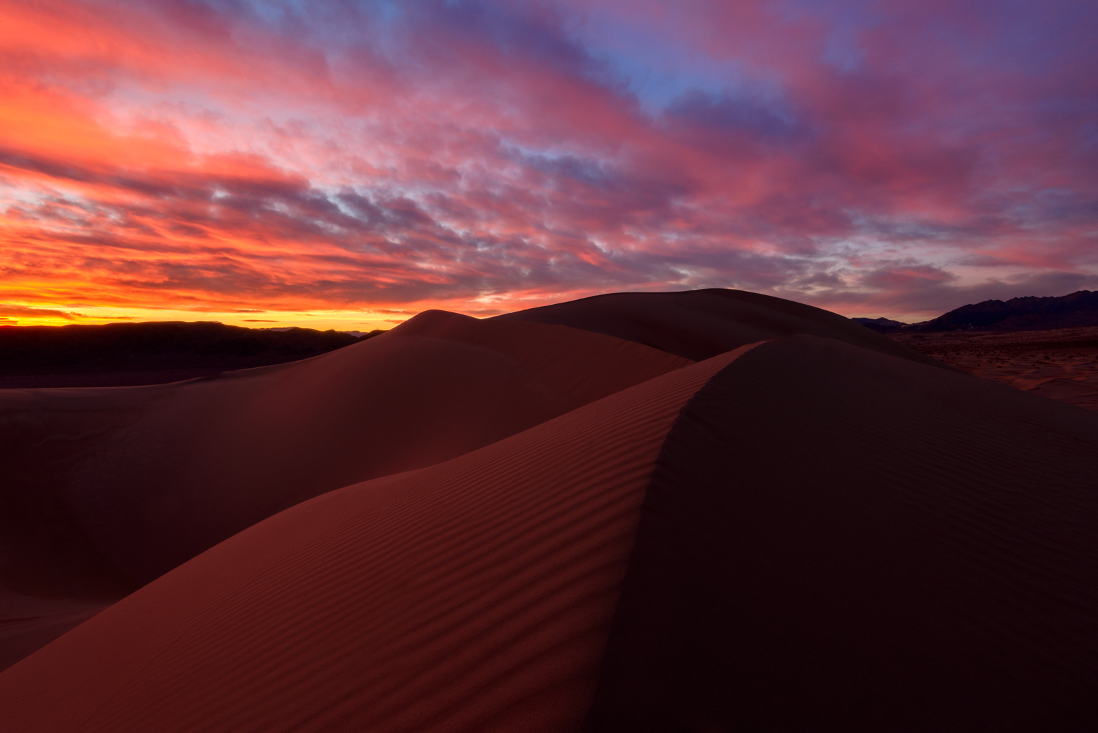 Winter sunset over the Ibex Dunes in Death Valley National Park.