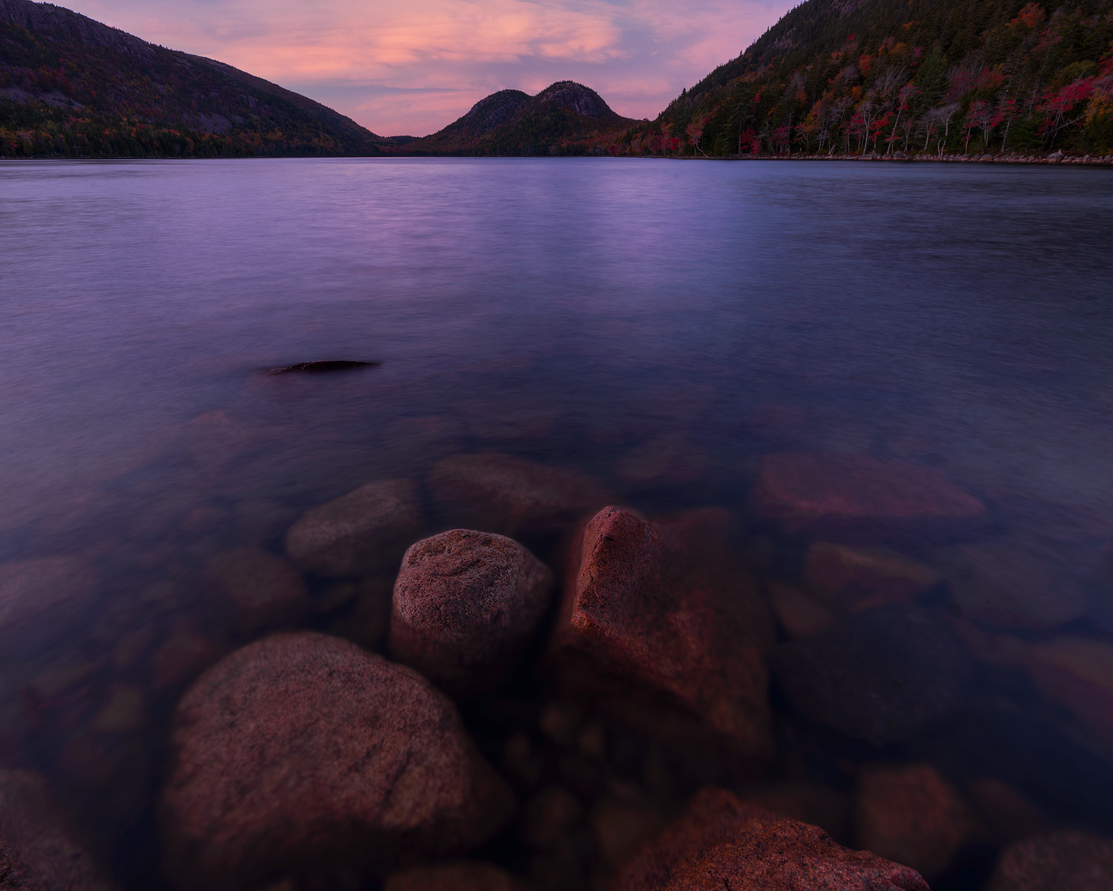 Sunset over Jordan Pond showing the Bubbles, two rounded mountains, in Acadia National Park, Maine.