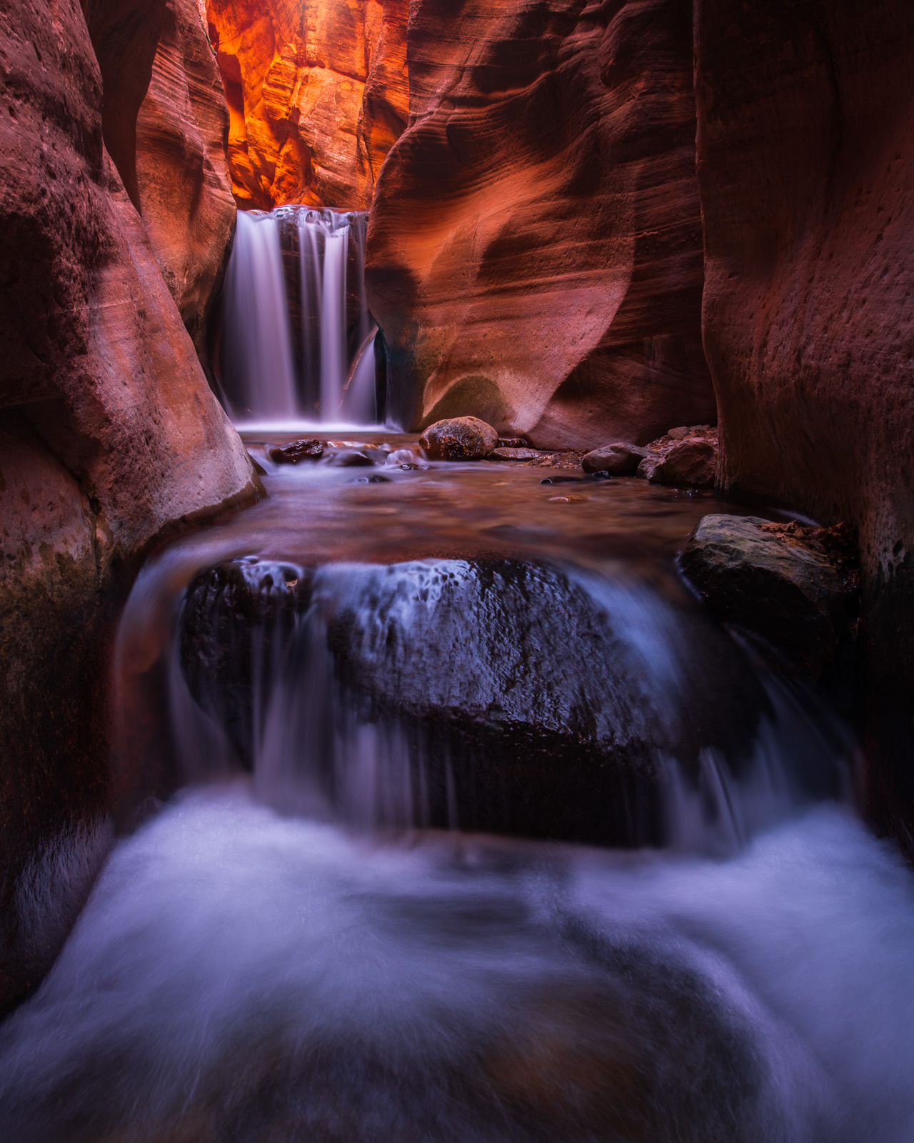 Waterfall in a small slot canyon just outside of Zion NAtional Park in southern Utah.