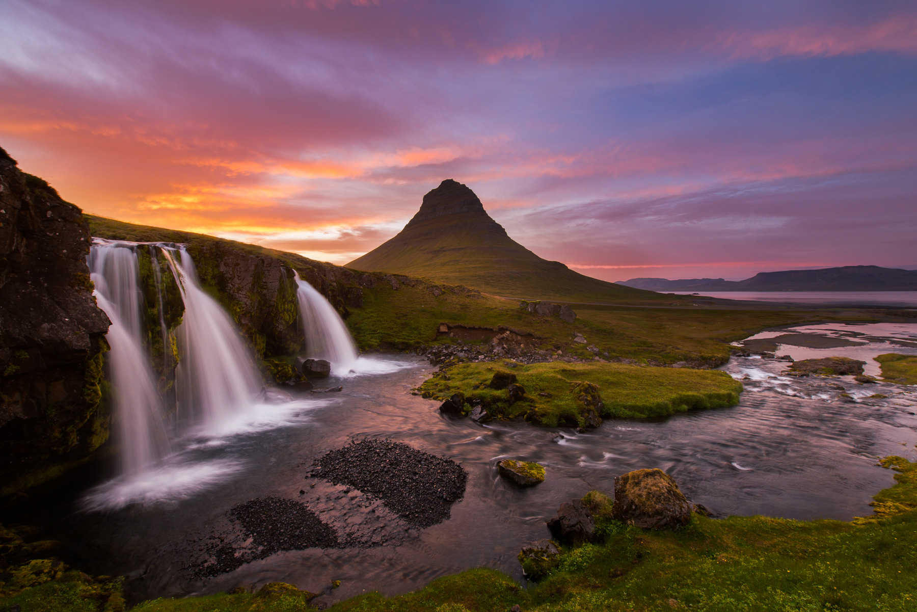 The skies above Kirkjufell (Church Mountain) erupted in a fiery display on this July evening in Iceland. Available Print Sizes...