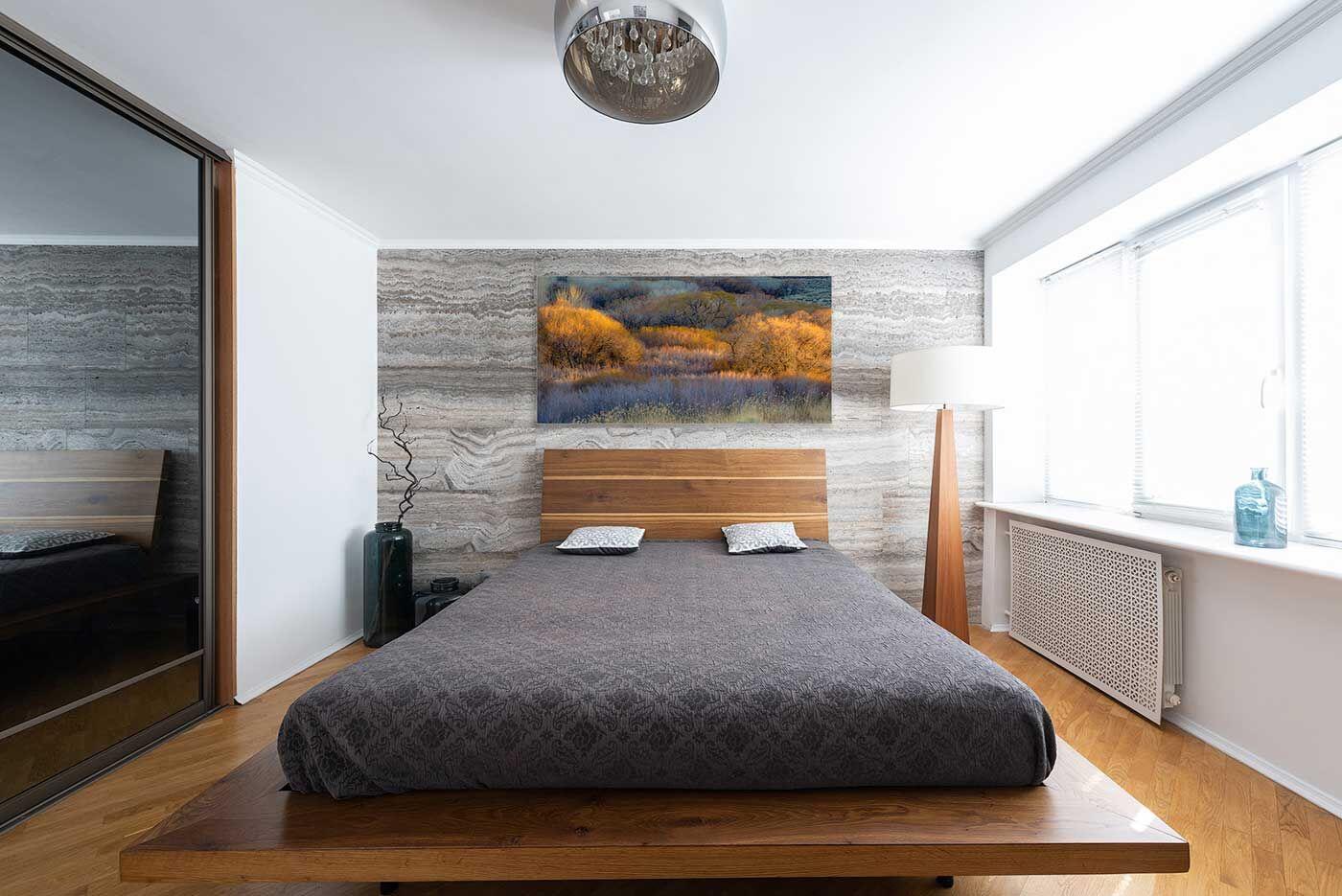 Metal Print Hanging on Bedroom Wall
