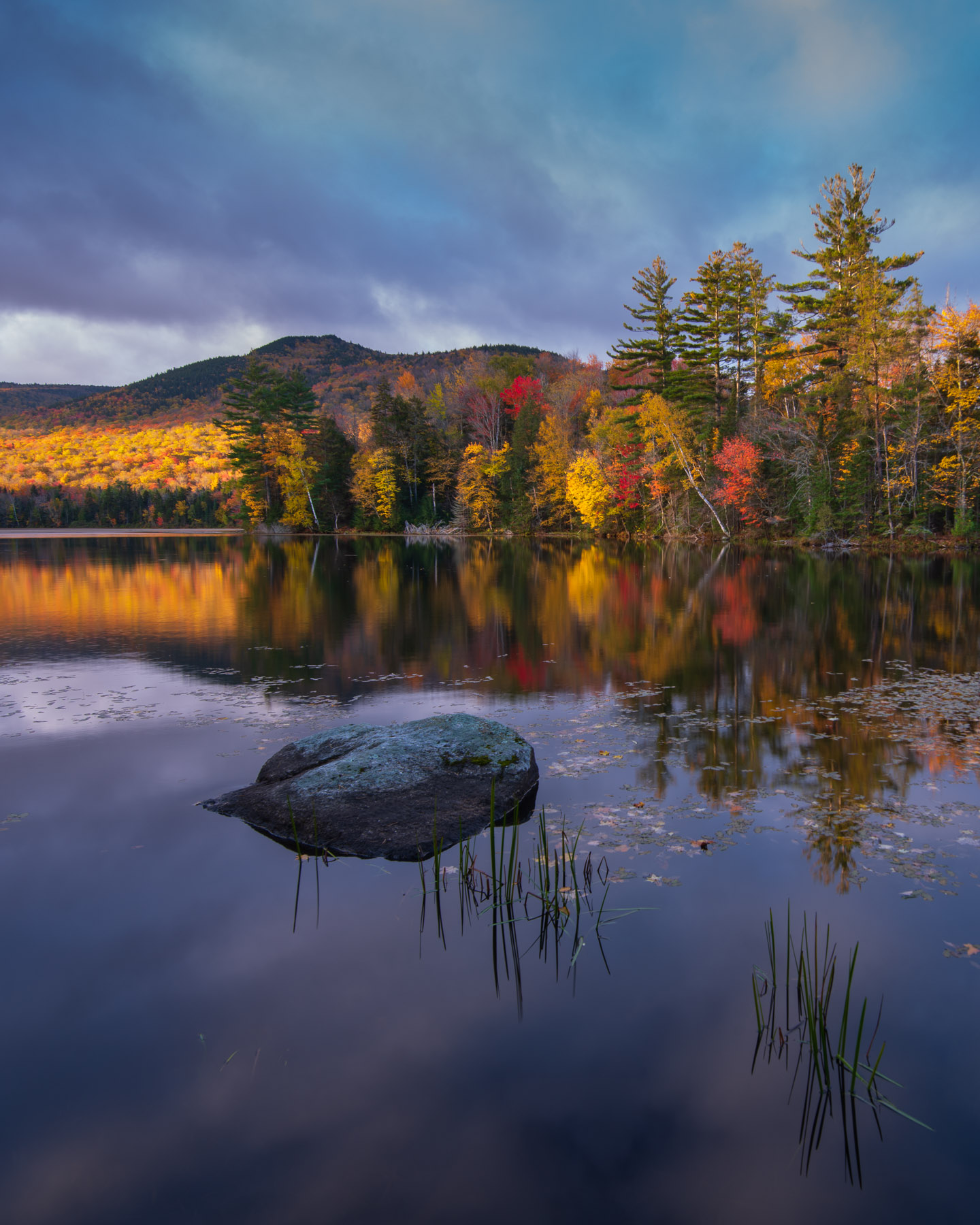 Autumn reflections at sunrise on Lefferts Pond, Green Mountain National Forest, Vermont.
