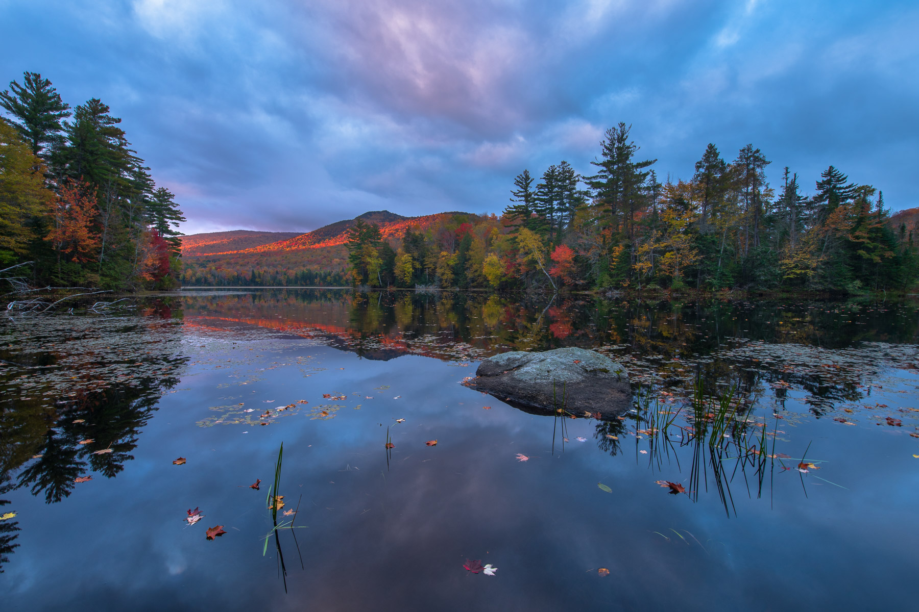 Autumn reflections on Lefferts Pond at sunrise, Green Mountain National Forest, Vermont.