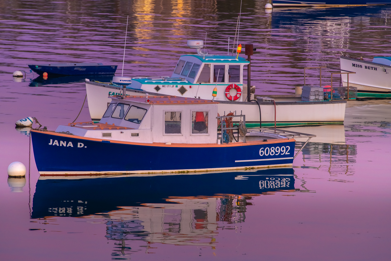 Two Lobster Boats in Bass Harbor at twilight on Mount Desert Island, Maine.