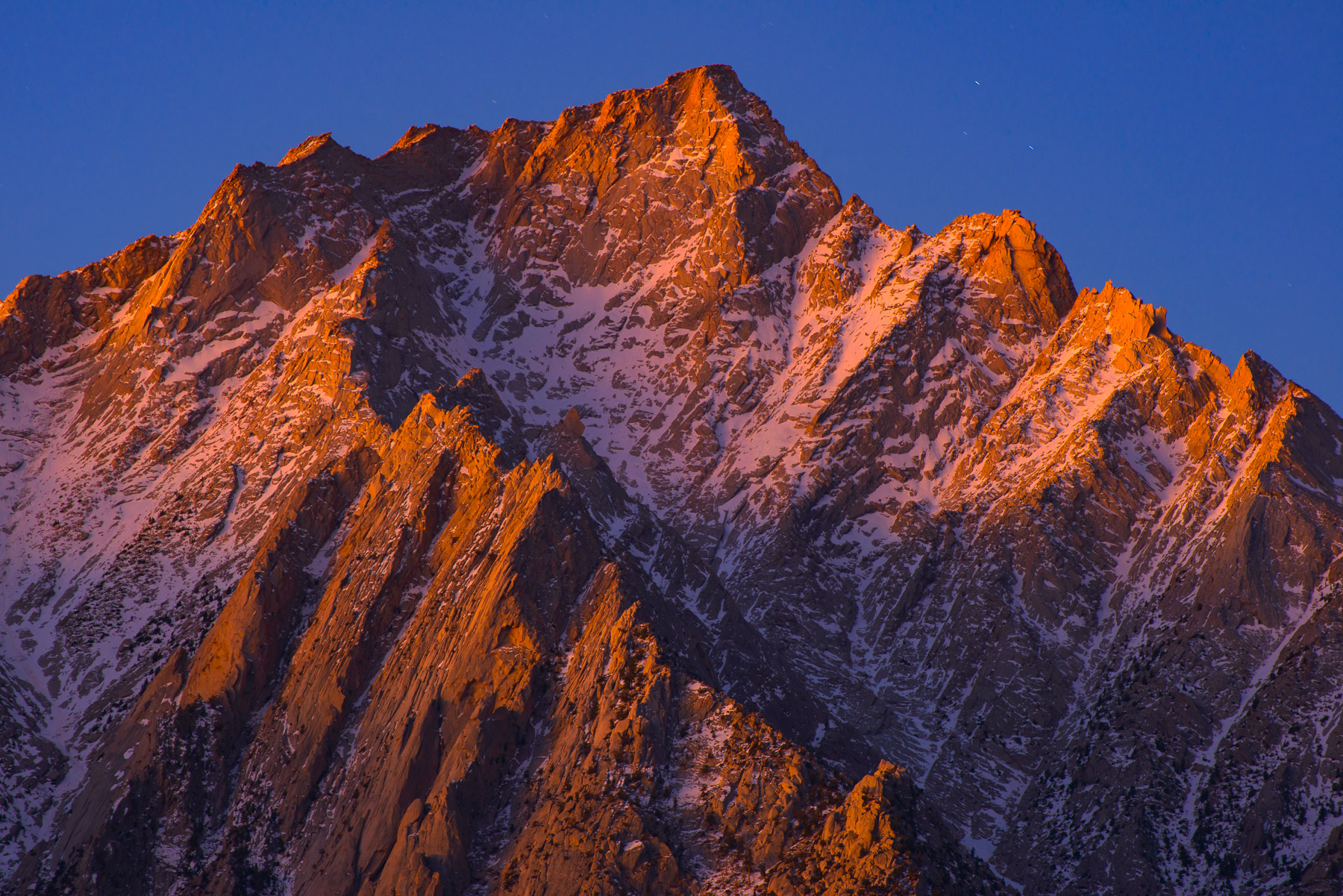 The rugged and towering Lone Pine Peak bathed in Alpenglow, Eastern Sierra Mountains, California. Available Print Sizes: 12x18...
