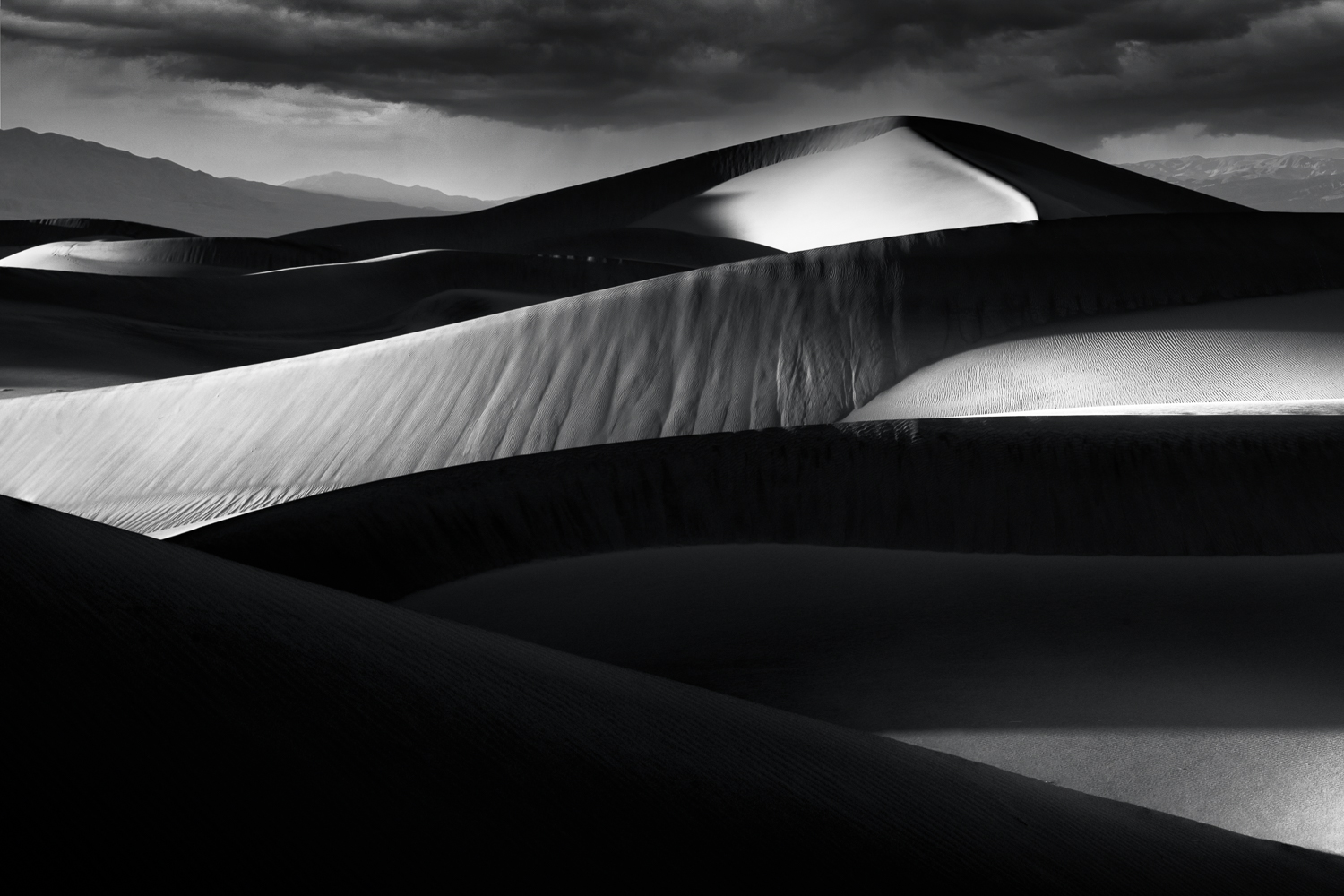 Mesquite dunes at sunset on a cold and windy winter day in Death Valleys vast wilderness.