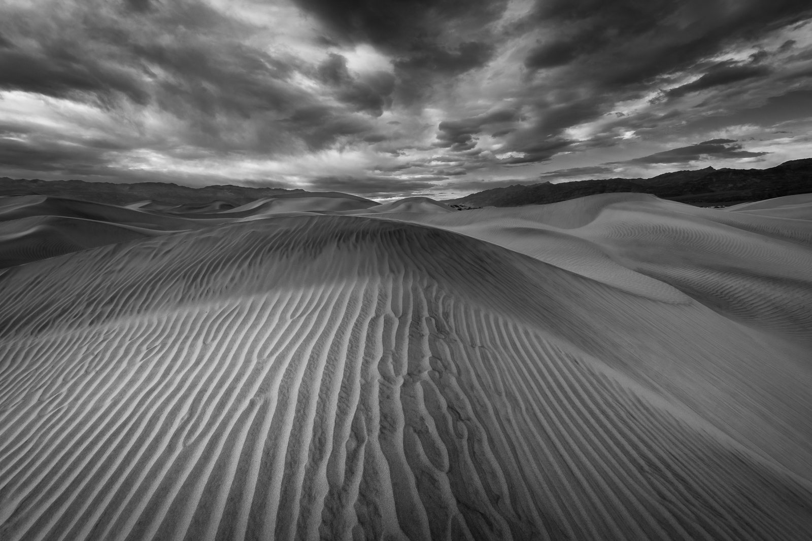 Approaching storm and high winds in Mesquite Sand Dunes, Death Valley National Park, California.