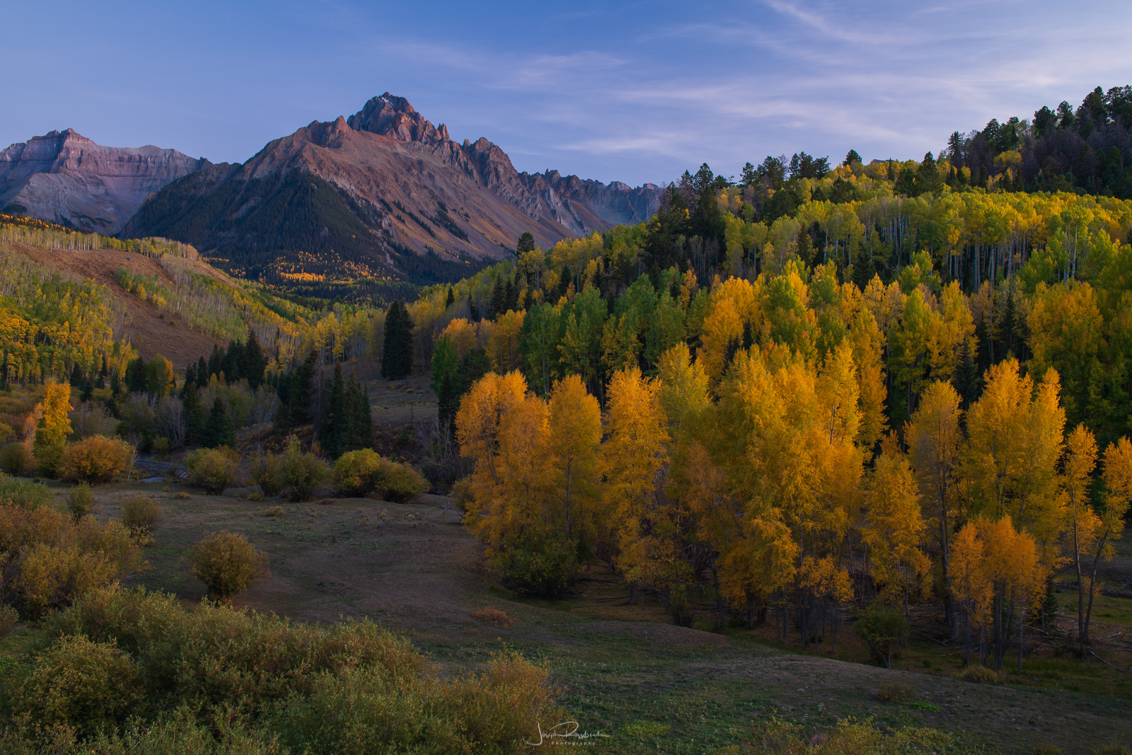 Autumn color below Mount Sneffels at twilight.