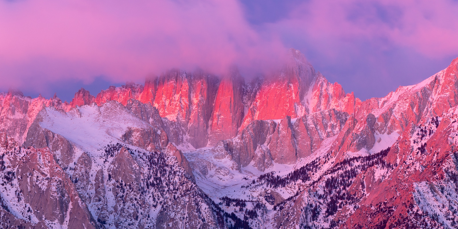 A clearing winter storm and Mount Whitney with majestic alpenglow at sunrise.Add beauty to your space with a Joseph Rossbach...