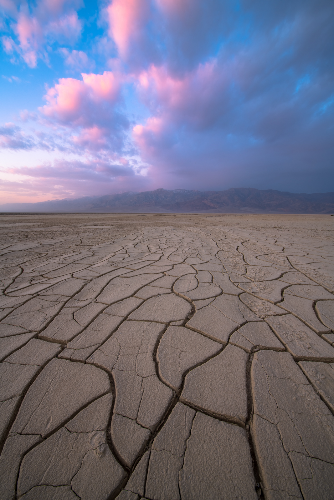 A dust storm over the Panimint Mountains viewed from mud flats in Death Valley National Park.