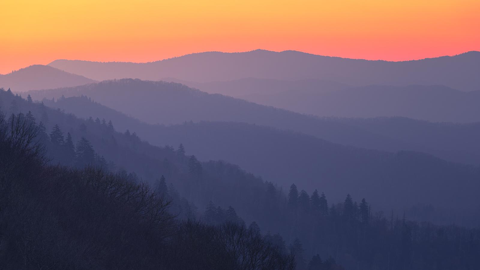 Mountain ridges layerd at sunrise from Oconoluftee Overlook.