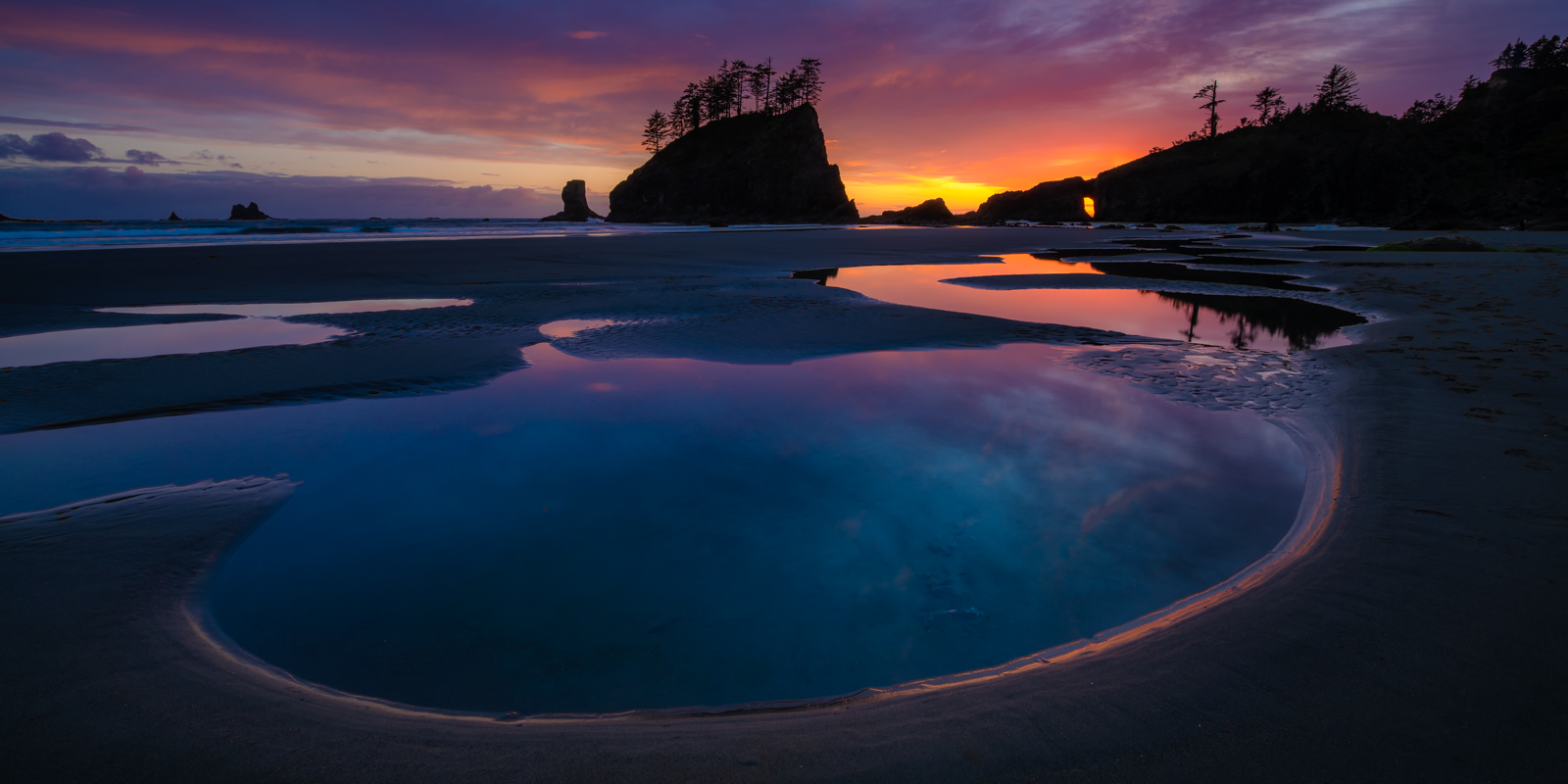 Tide pools below the towering sea stacks along Second Beach, Olympic National Park. Available Print Sizes: 8x16, 12x24,15x30...