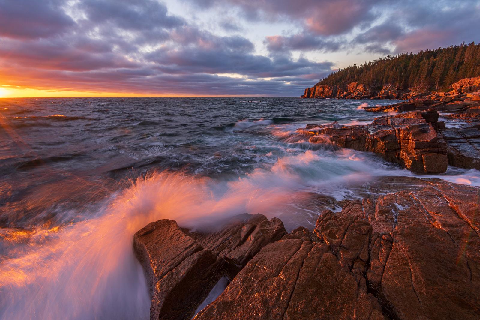 Breaking waves below Otter Cliffs at sunrise.