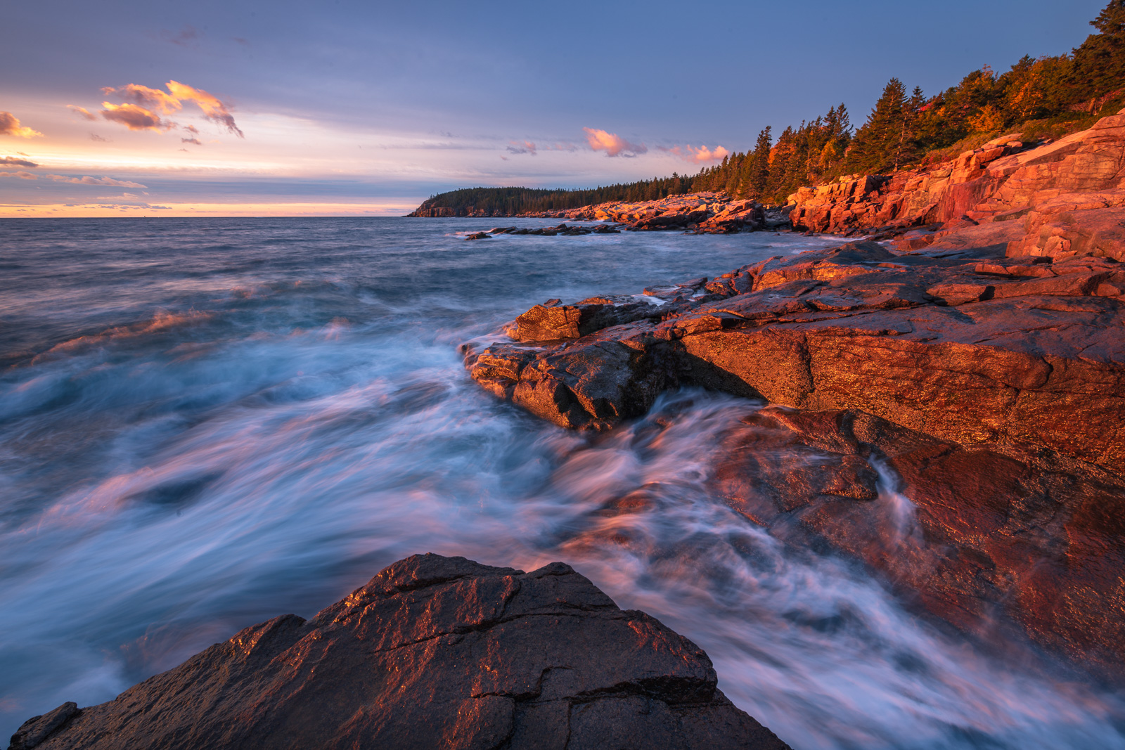 Breaking waves and first light paint Acadia's rugged coastline from Thunderhole.