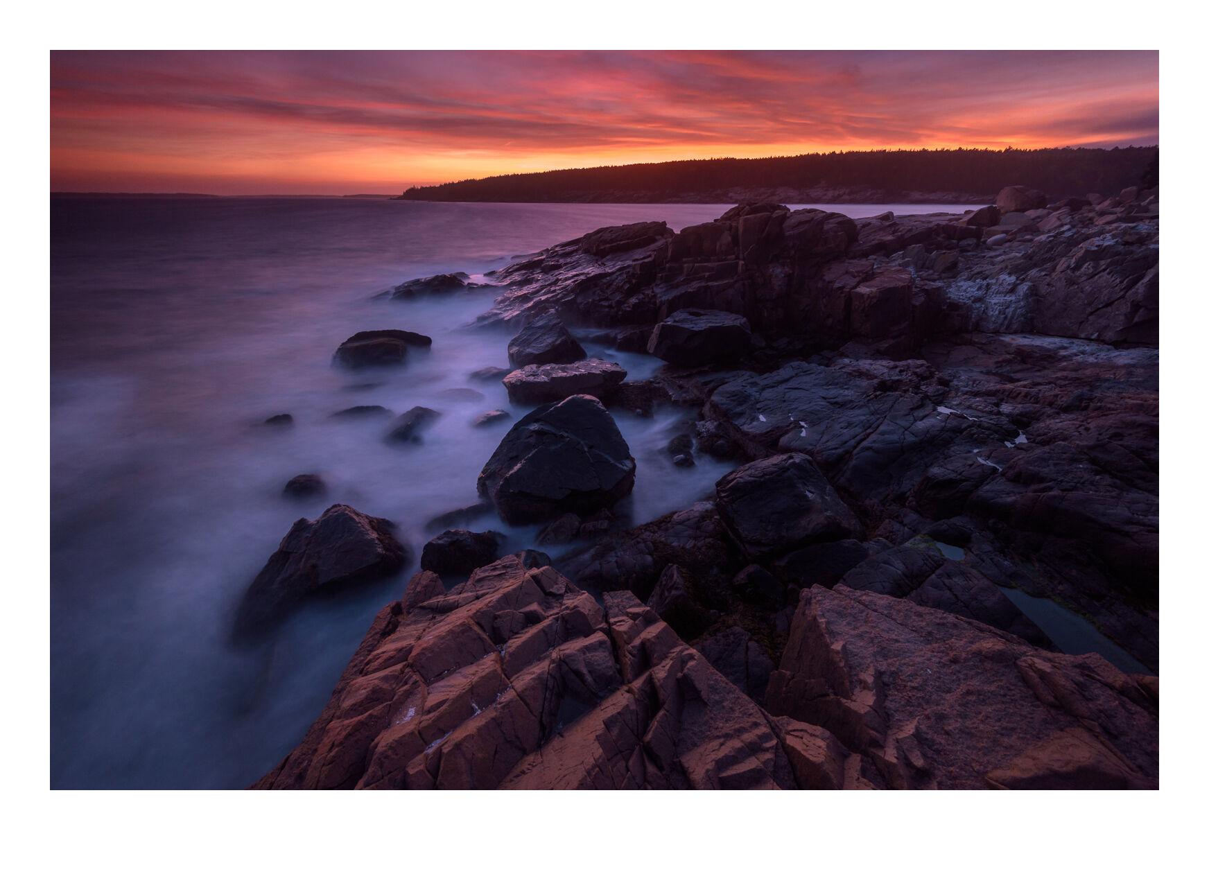 Sunset over Acadia's rugged granite coastline.