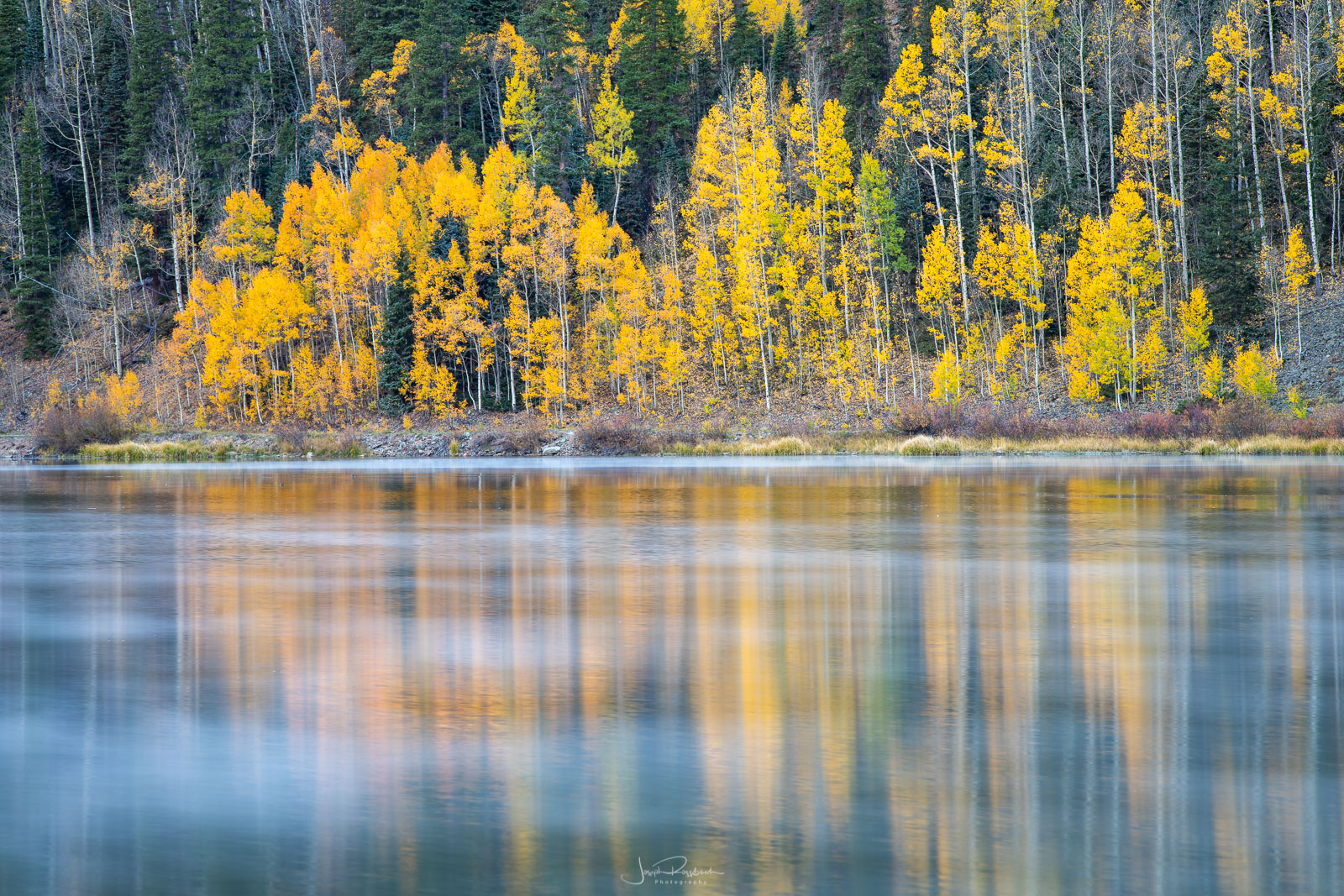Morning reflections on Crystal Lake with peak autumn color.
