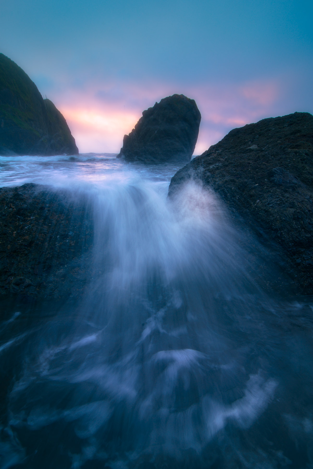 A breaking wave at sunset along Olympic National Park's Ruby Beach.