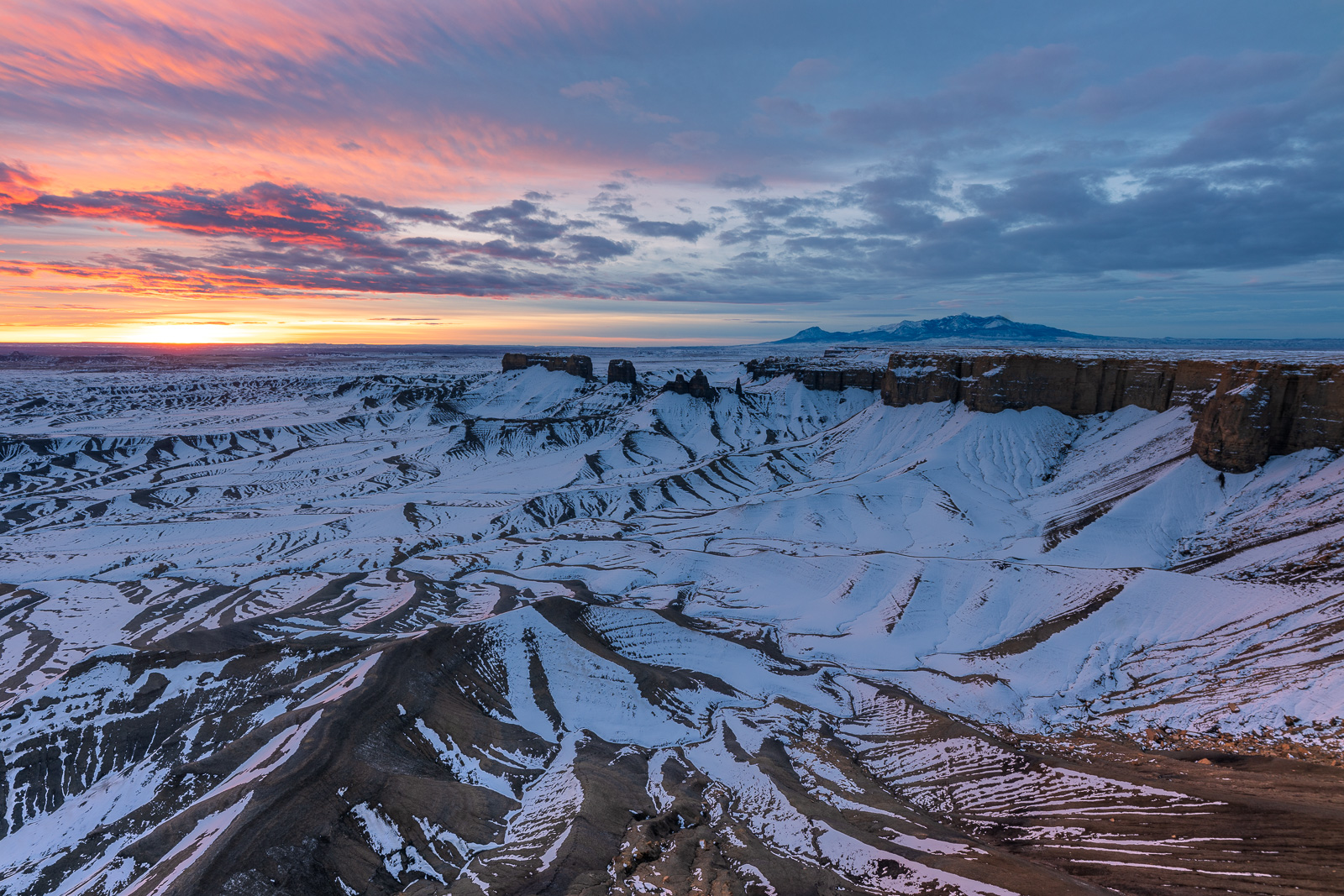 A remarkable winter sunrise over the Utah Badlands outside of Capitol Reef National Park.