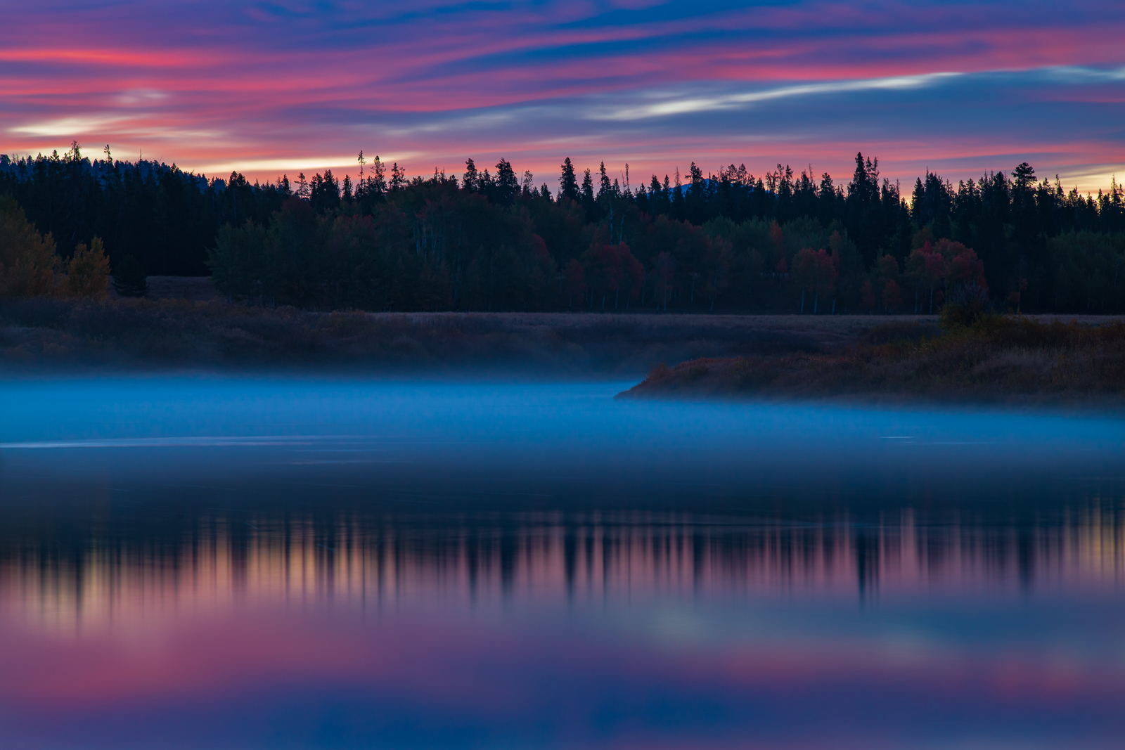 Autumn sunrise reflections along the Snake River near Ox Bow Bend.Add beauty to your space with a Joseph Rossbach limited edition...
