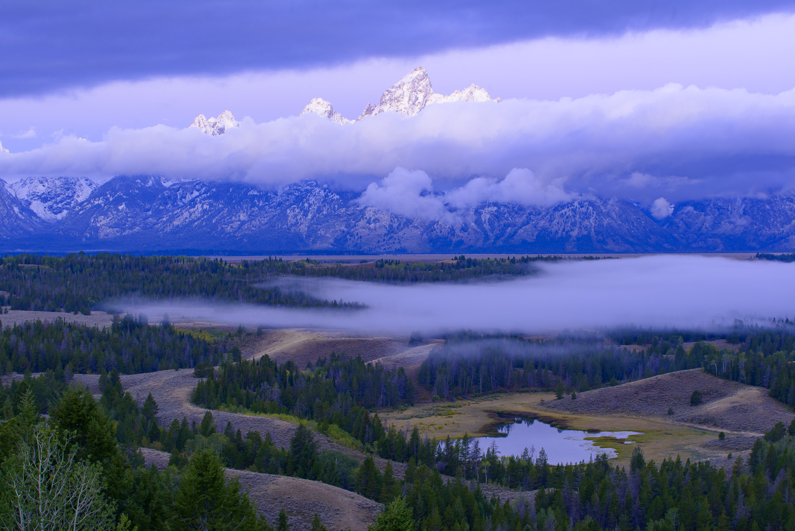 Morning clouds and fog at twilight, Grand Tetons, Wyoming.