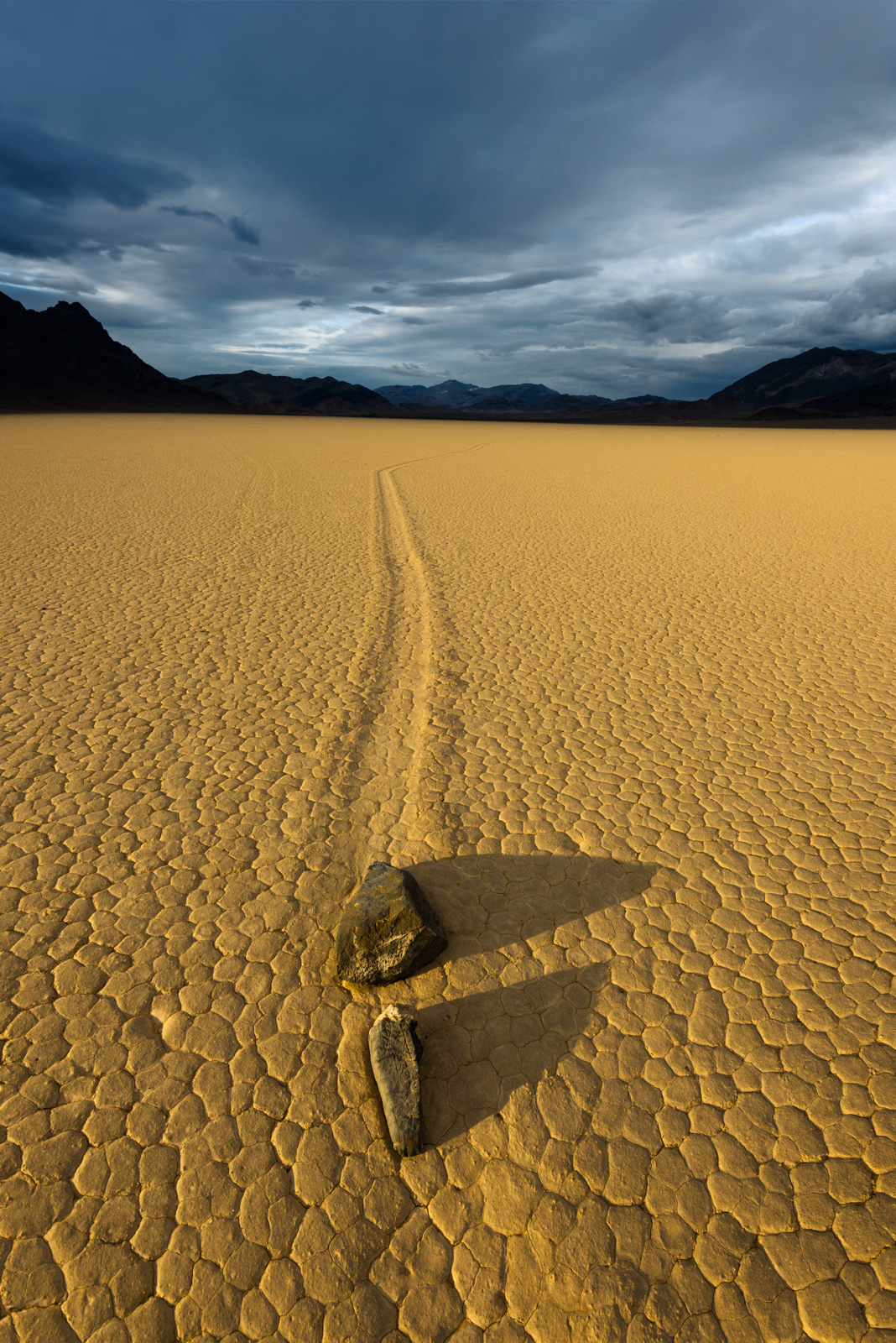 Moving rocks along the mysterios Racetrack Playa in Death Valley's backcountry.
